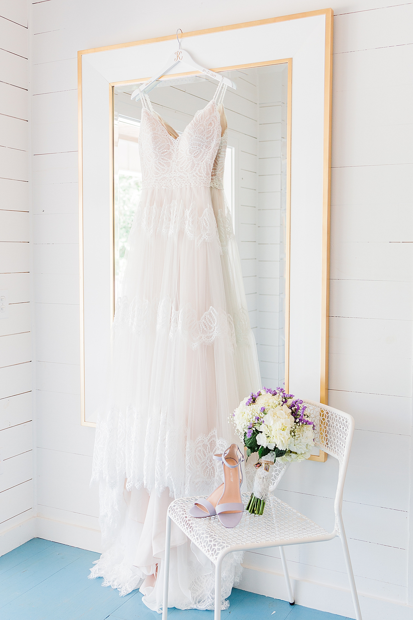 bride's dress hangs in Fairhope AL