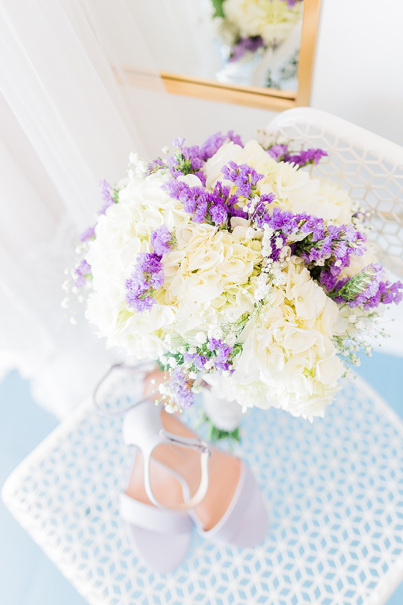 bride's bouquet with ivory and purple florals