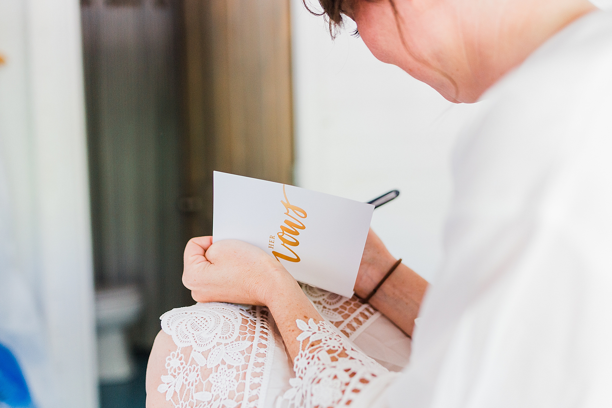 bride writes in vow booklet before AL wedding