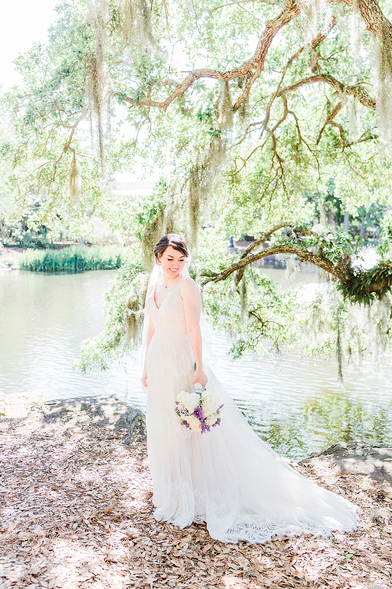 bridal portraits under tree with Spanish Moss