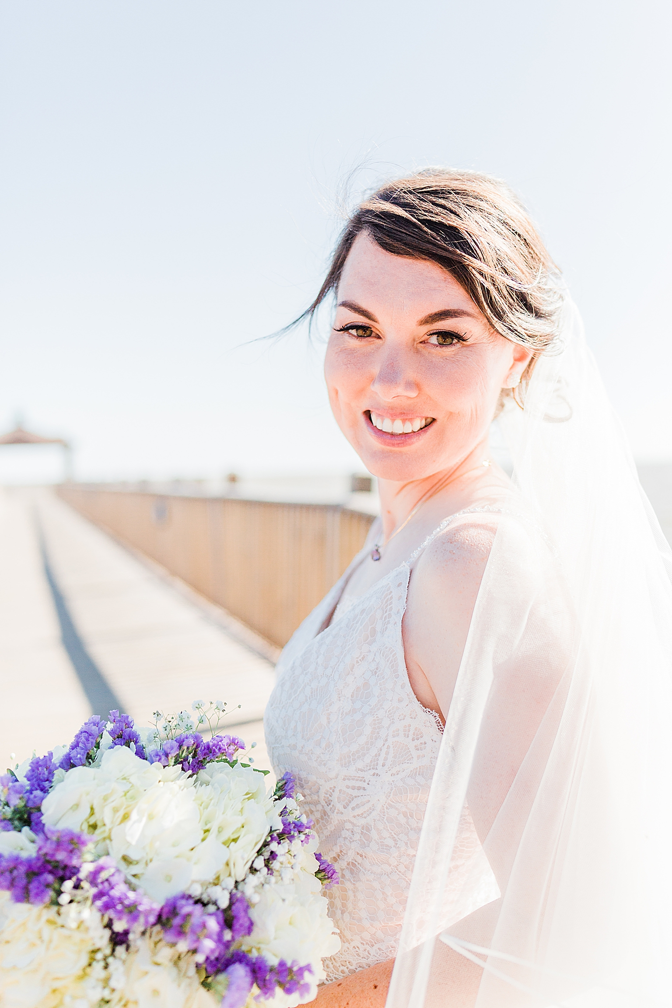 bride poses on walkway in Fairhope AL