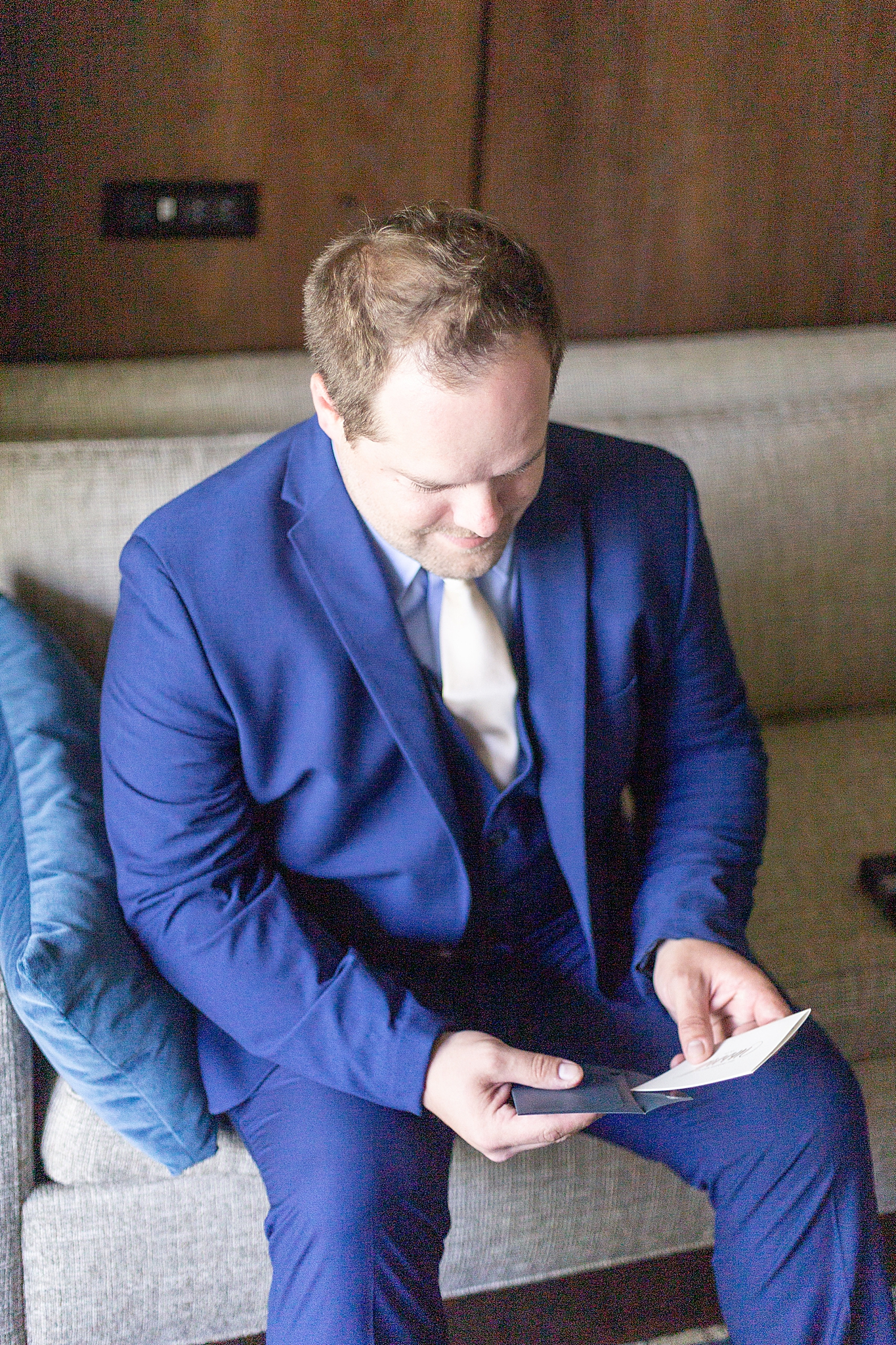 groom reads letter from bride on Alabama wedding day