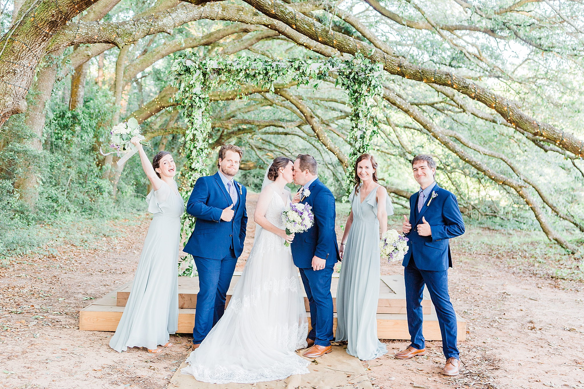 bride and groom pose with bridal party in Fairhope AL