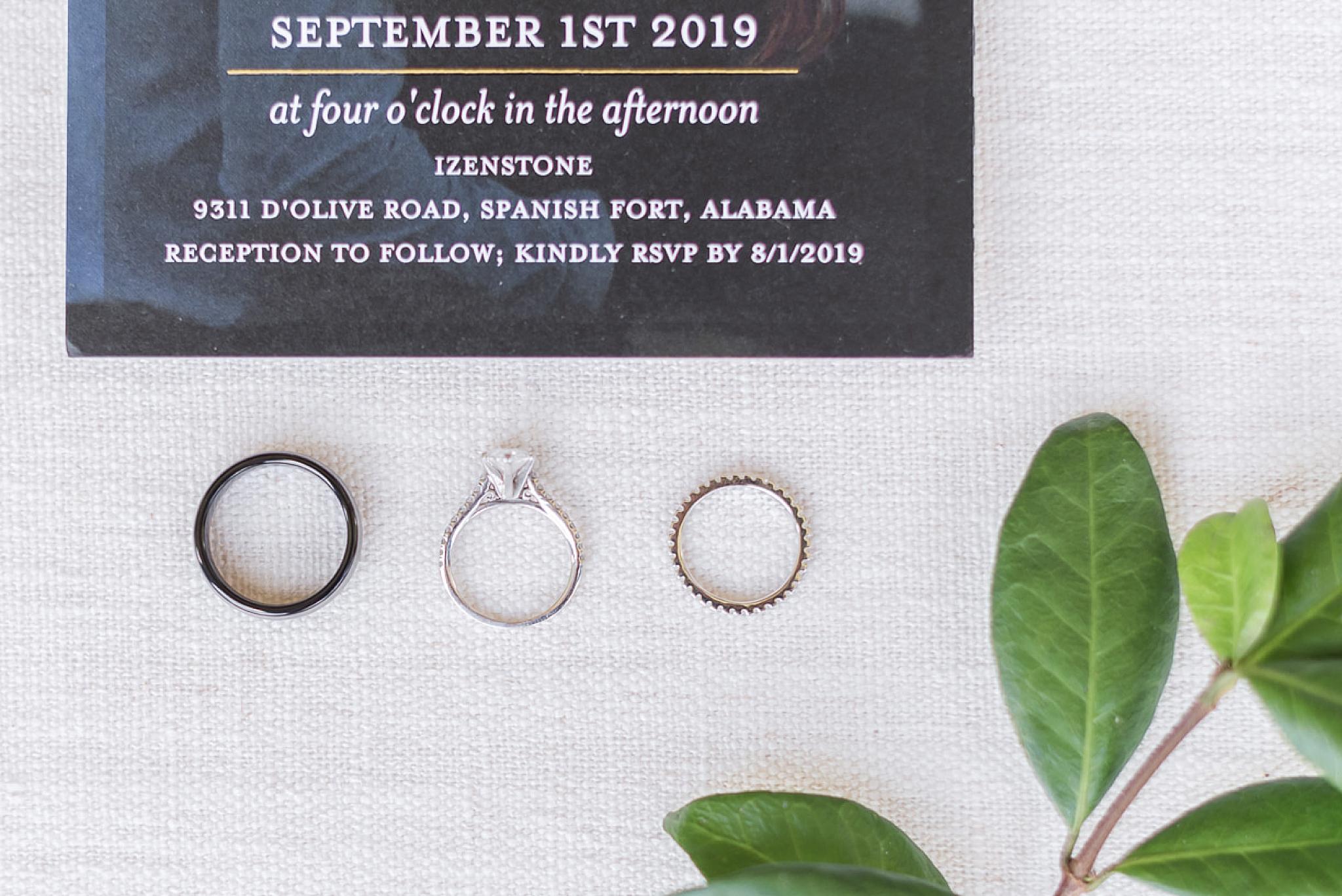 wedding rings lay beneath invitation for fall wedding