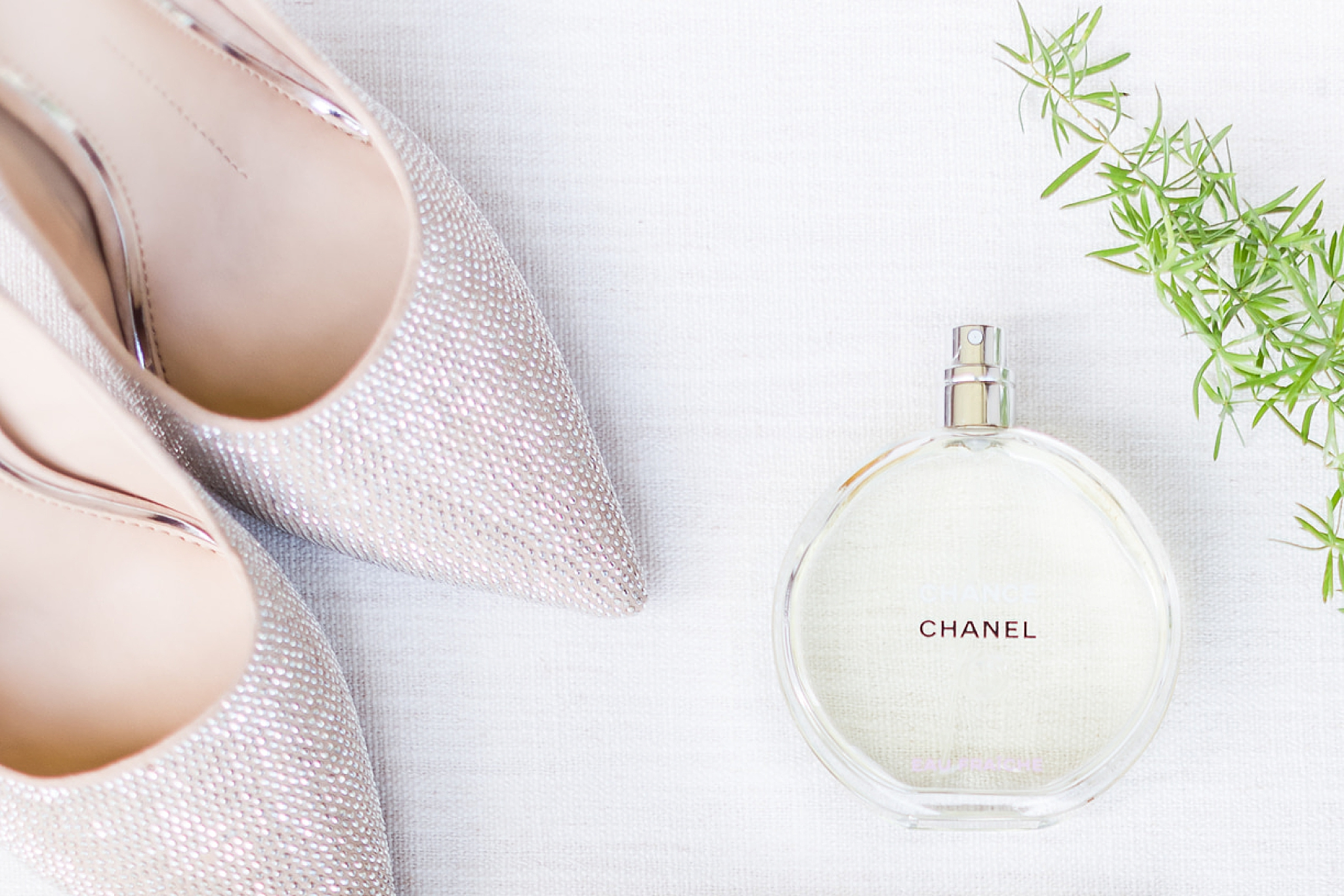 bride's shoes and Chanel perfume bottle