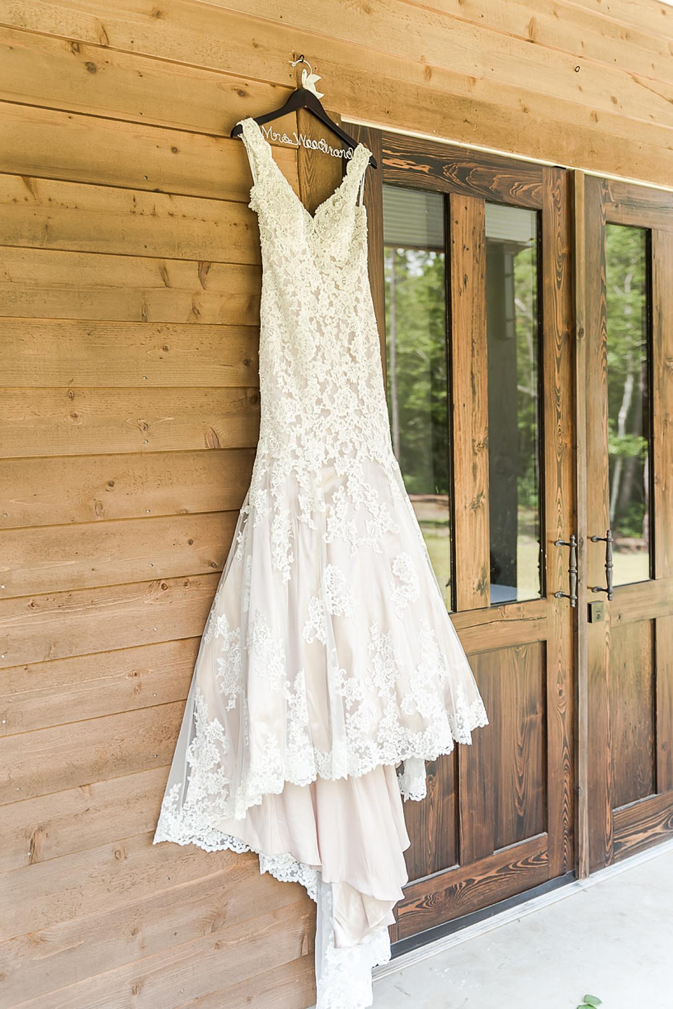 bride's dress hangs at Izenstone in Spanish Fort AL