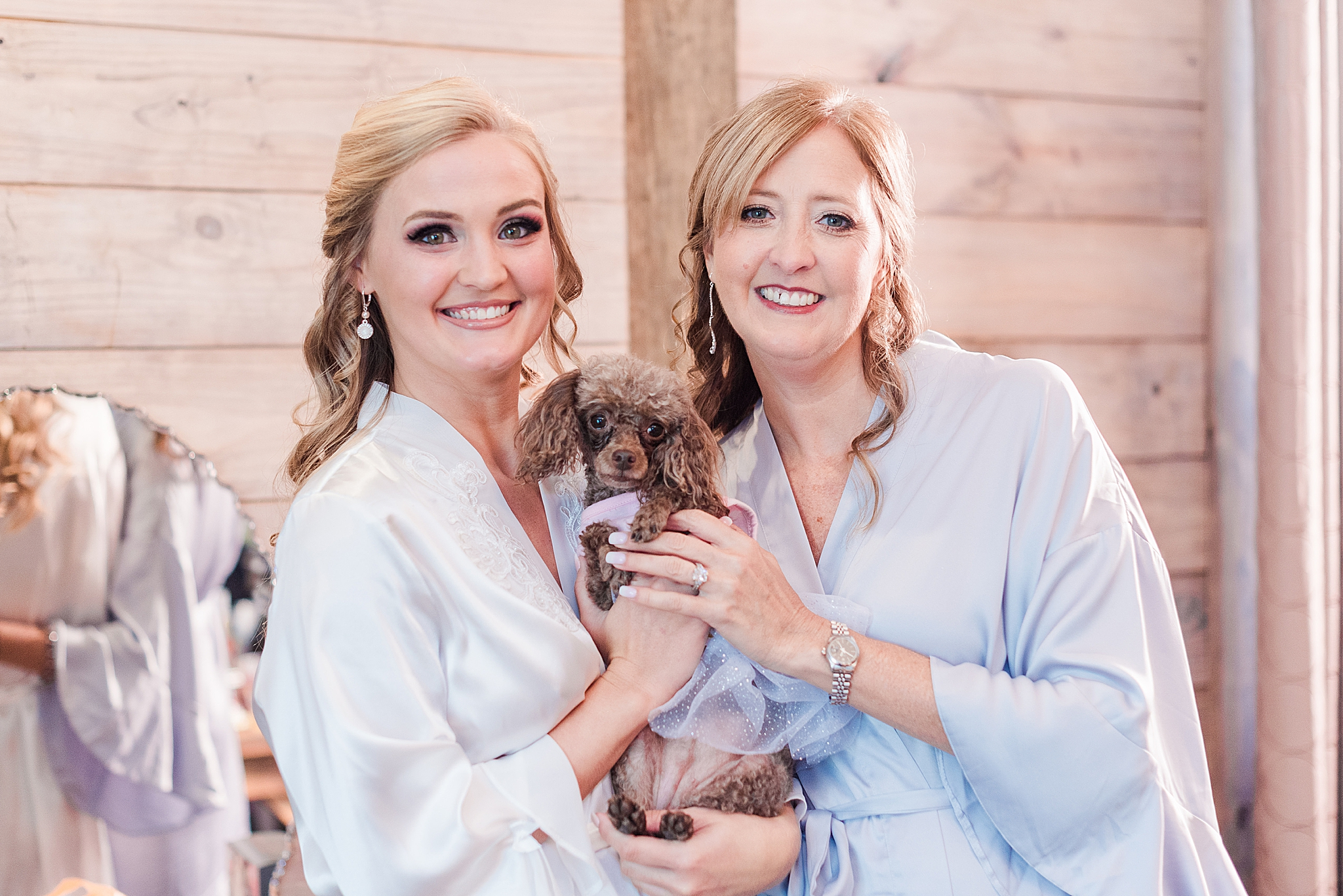bride and mom pose with puppy dog at Izenstone