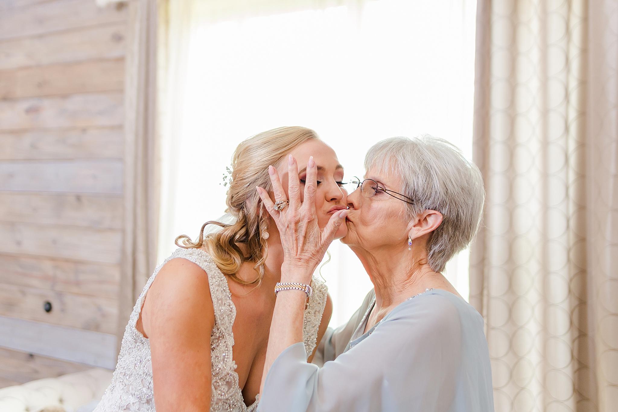 grandmother kisses bride on wedding day