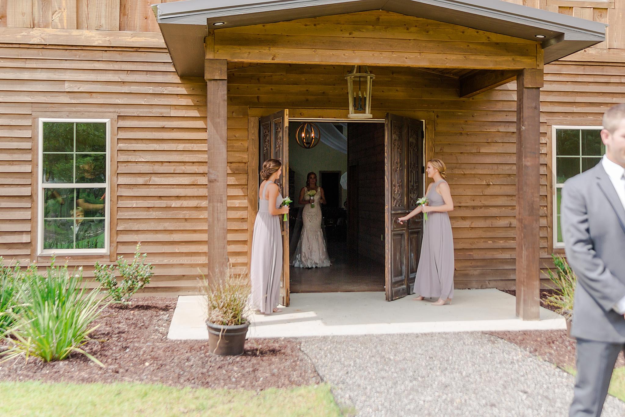 bridesmaids open door for bride's first look