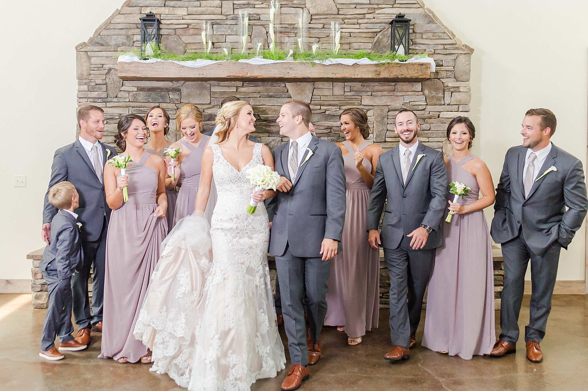 Alabama wedding party poses in front of fireplace