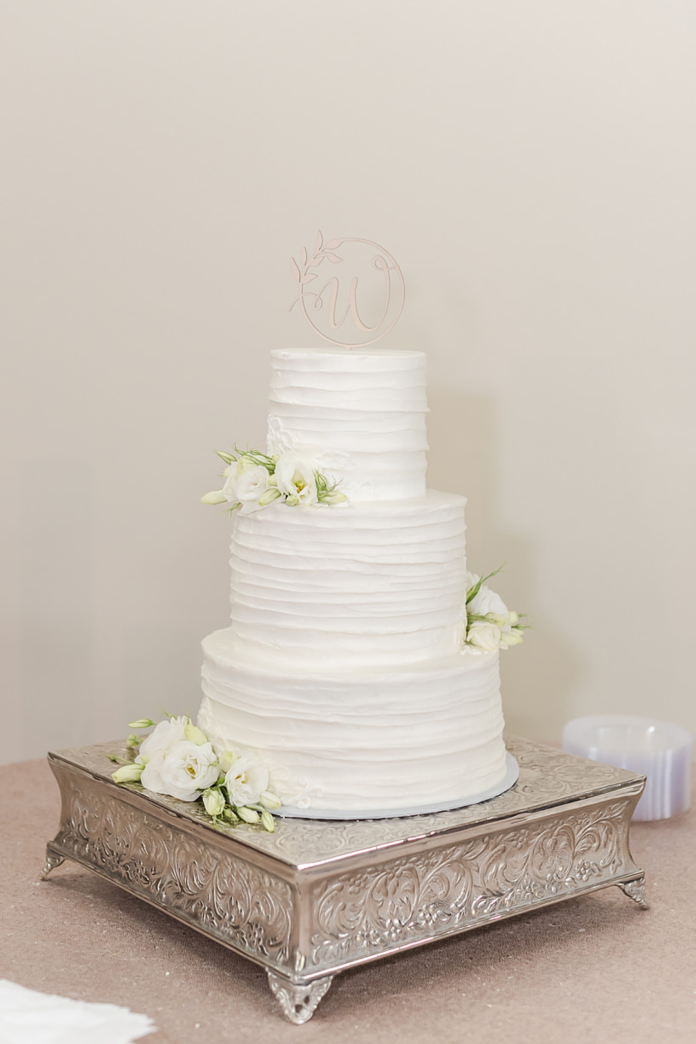 tiered wedding cake with simple cake topper
