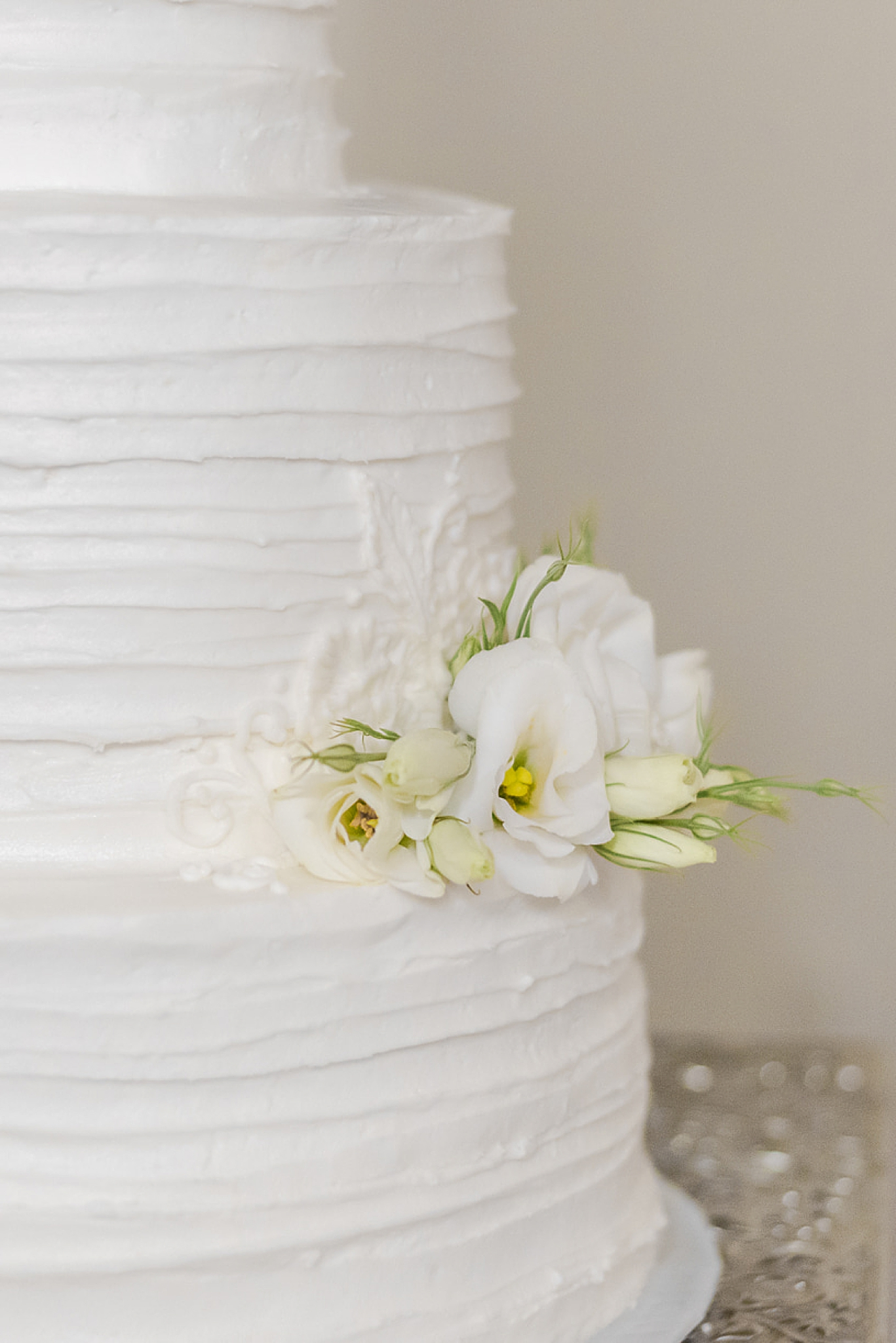floral details on white wedding cake
