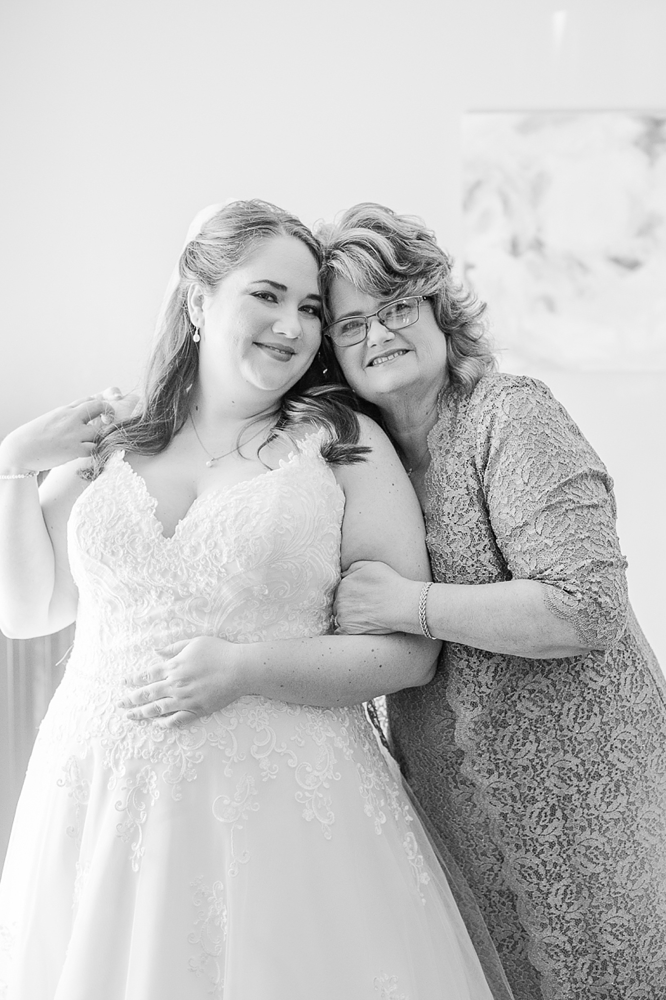 mom and daughter pose together during wedding morning