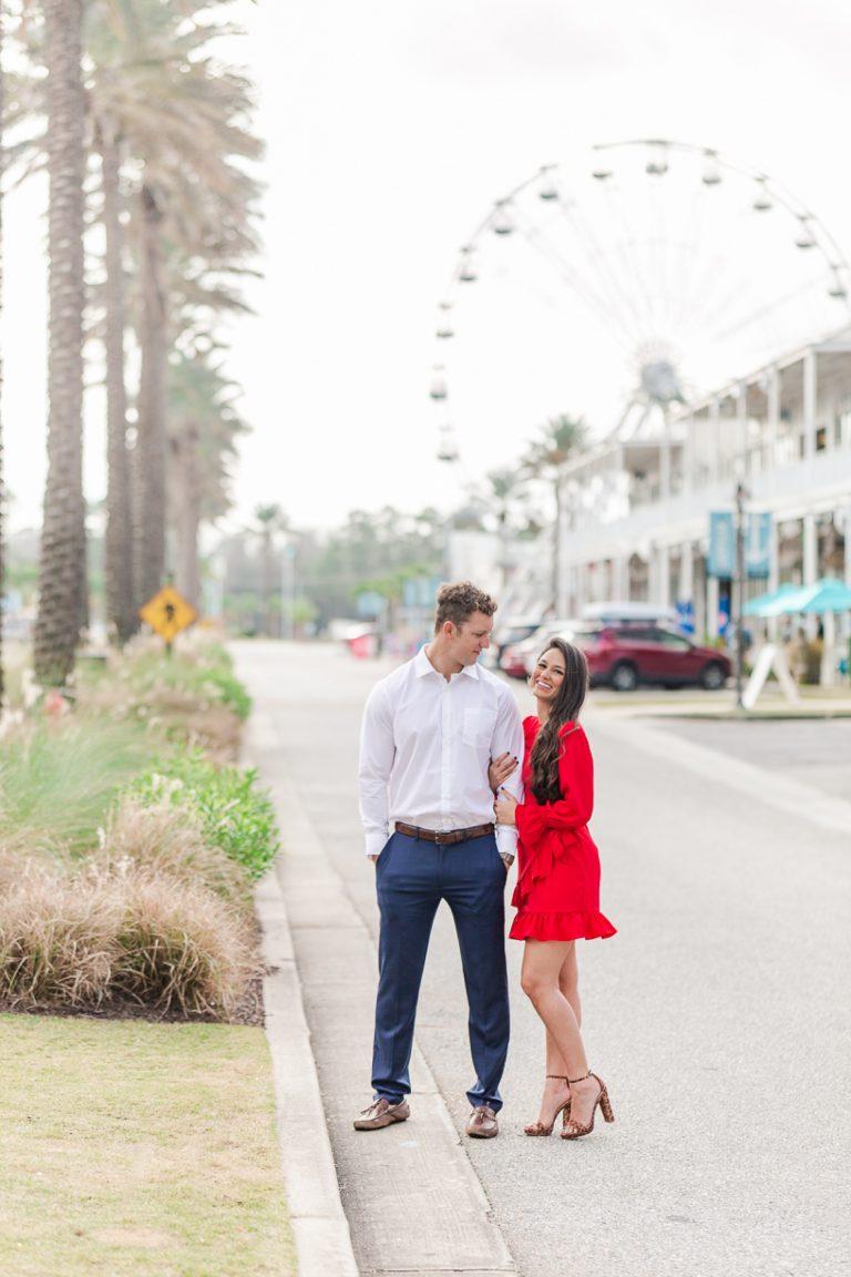 couple walks along street at The Wharf