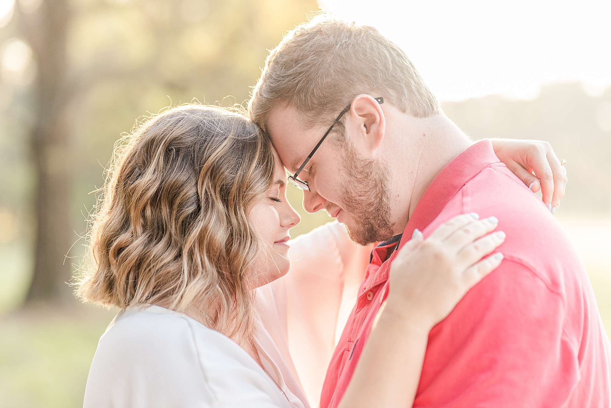 couple stands touching foreheads during Gulf State Park portraits