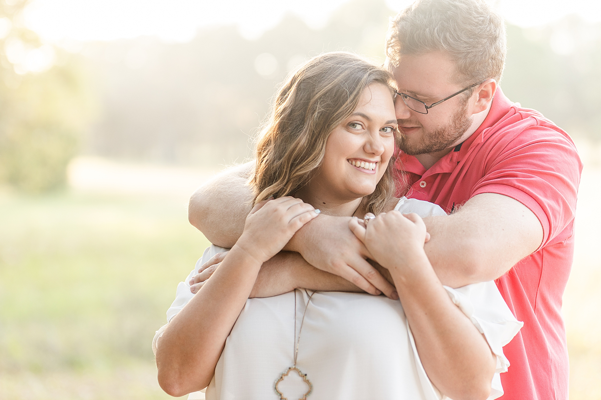 bride and groom hug during Gulf State Park engagement photos
