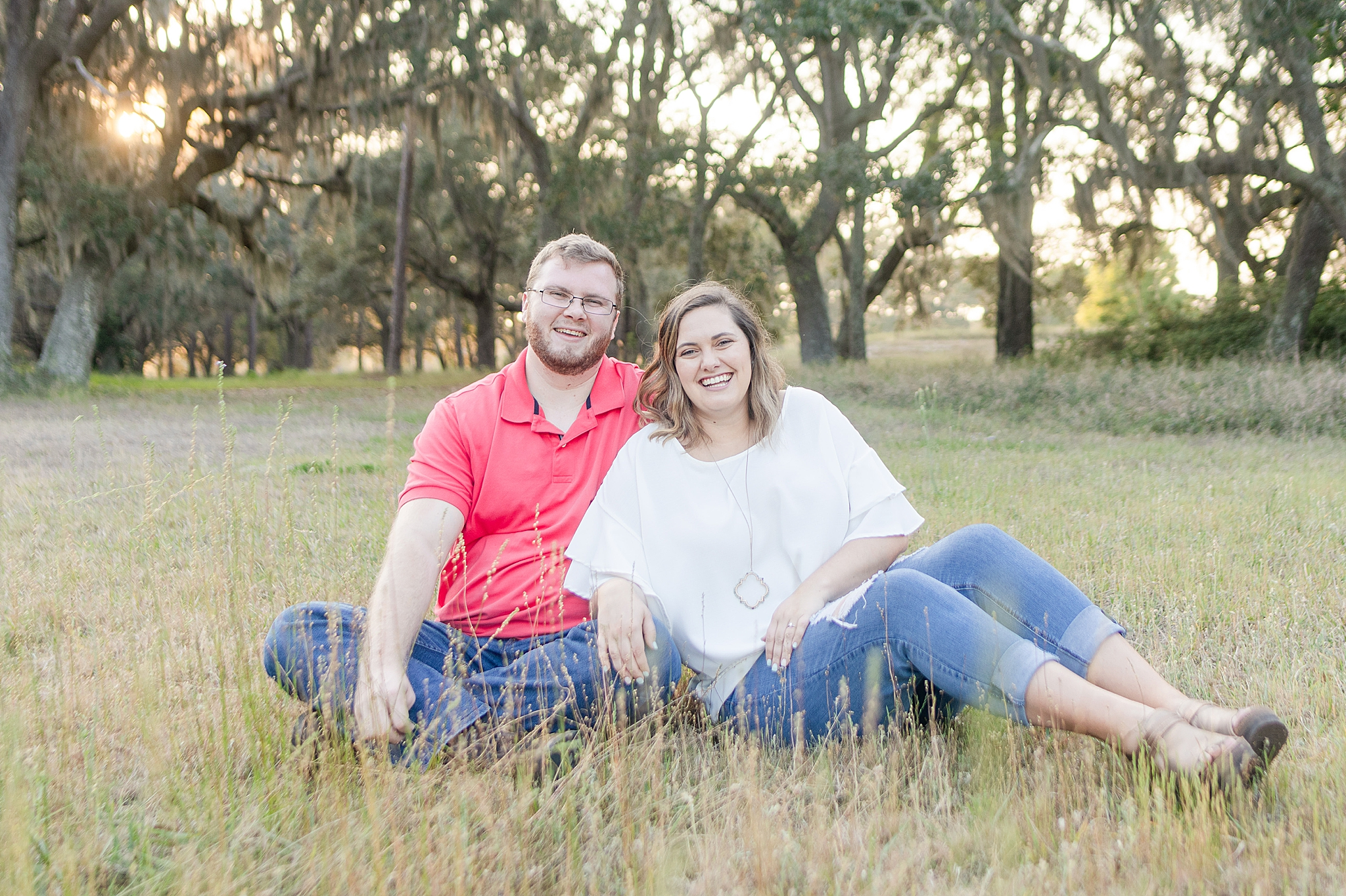 summer engagement session at Gulf State Park with couple in casual clothes