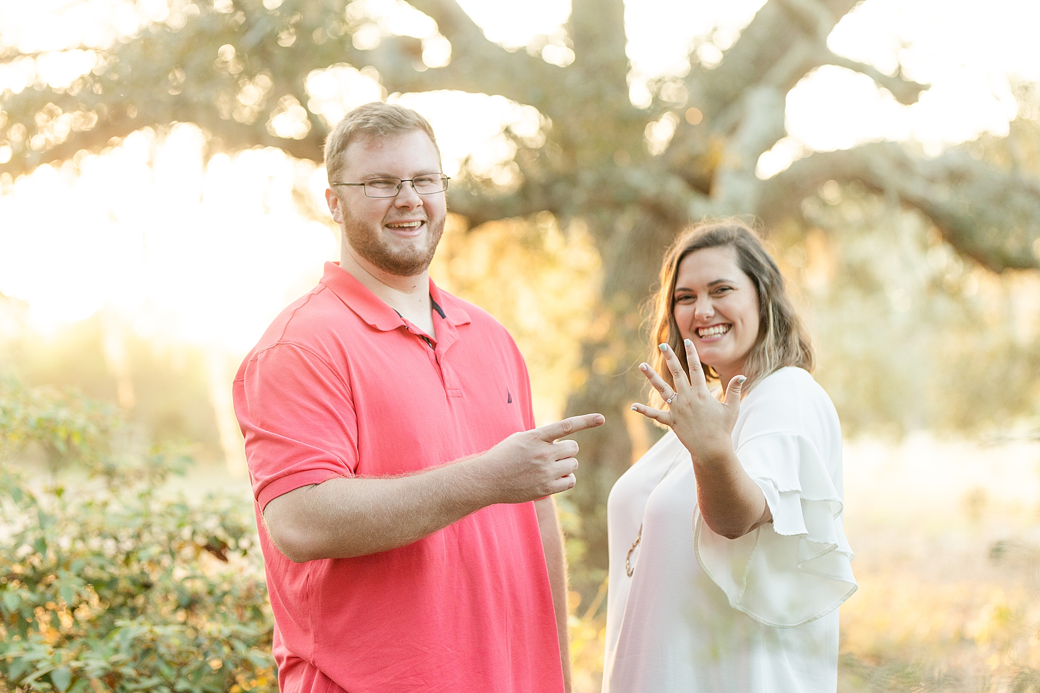 bride shows off engagement ring