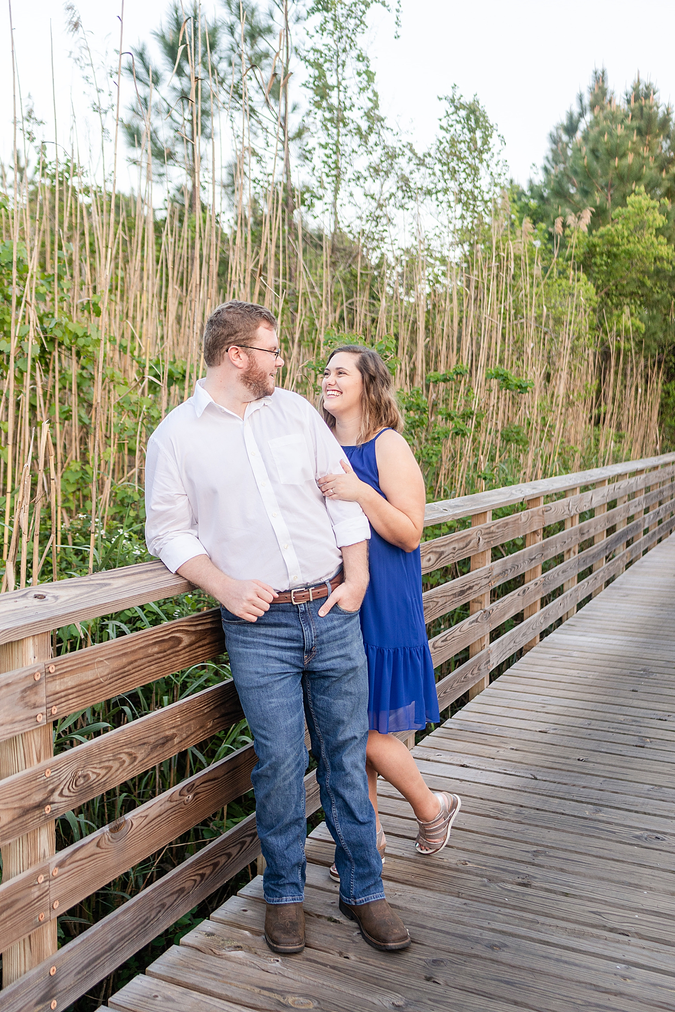 Gulf State Park engagement session on wooden pathway