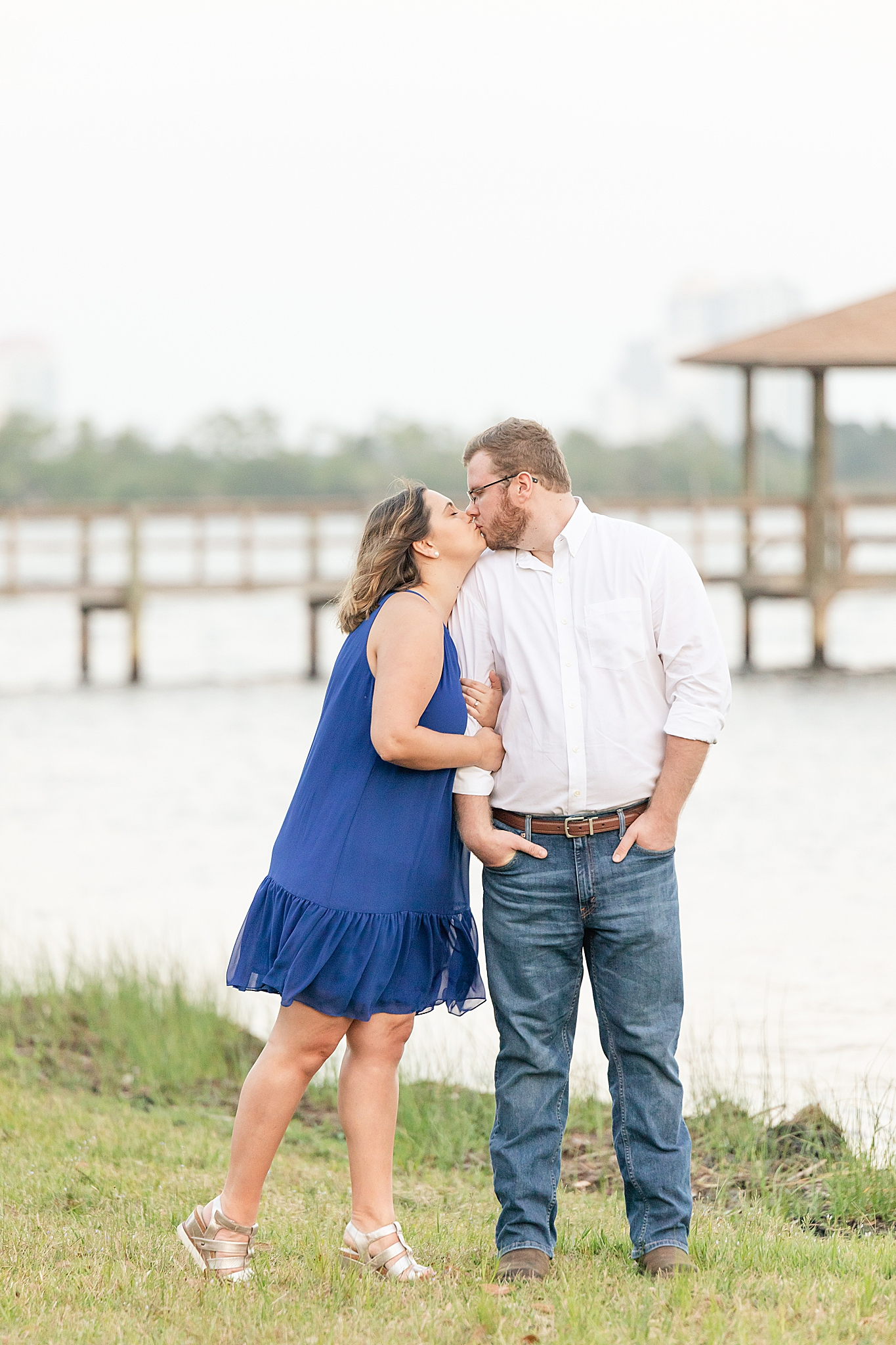 engaged couple kisses by Gulf in Alabama