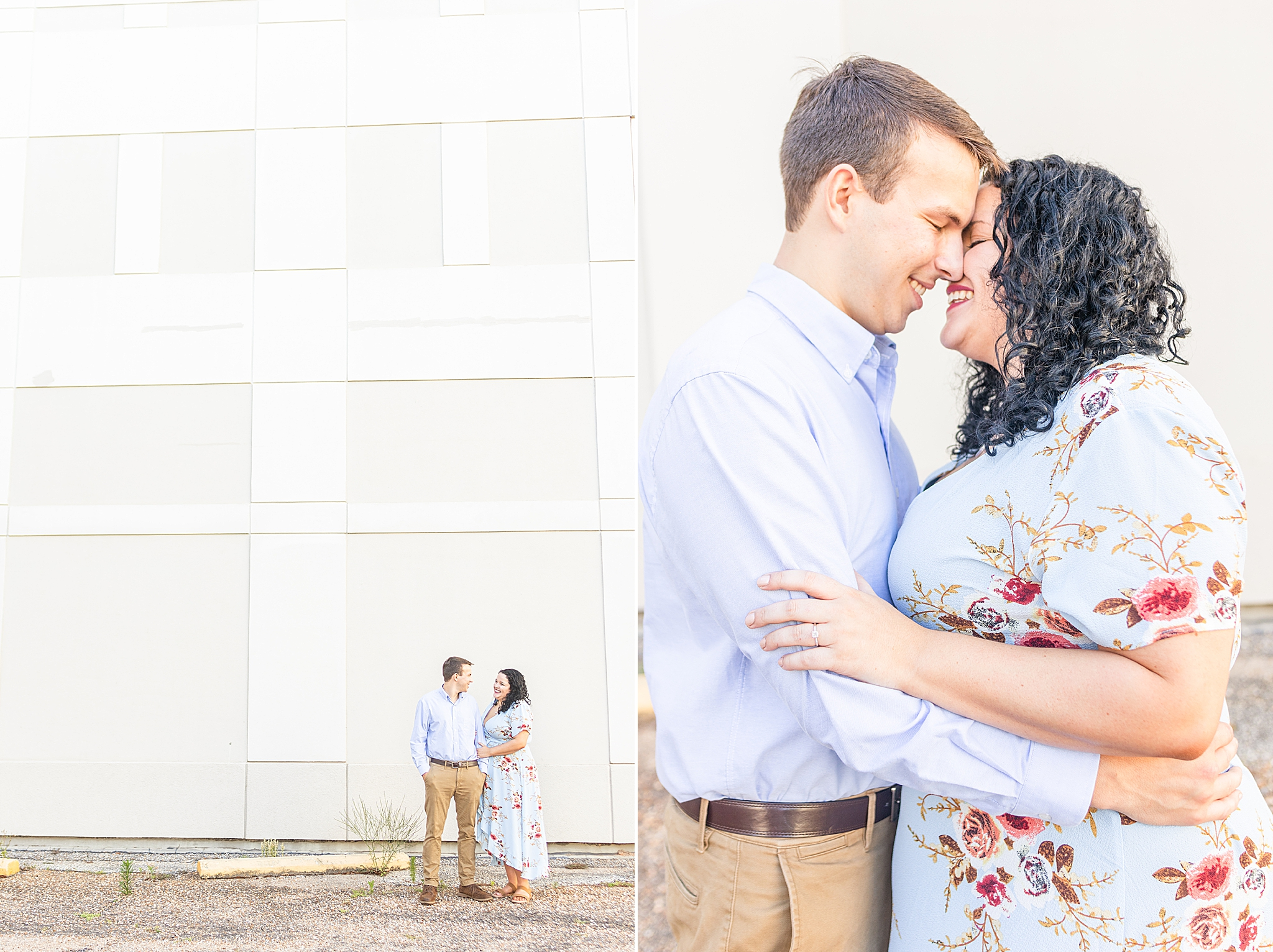 engaged couple poses by white wall in downtown Fairhope