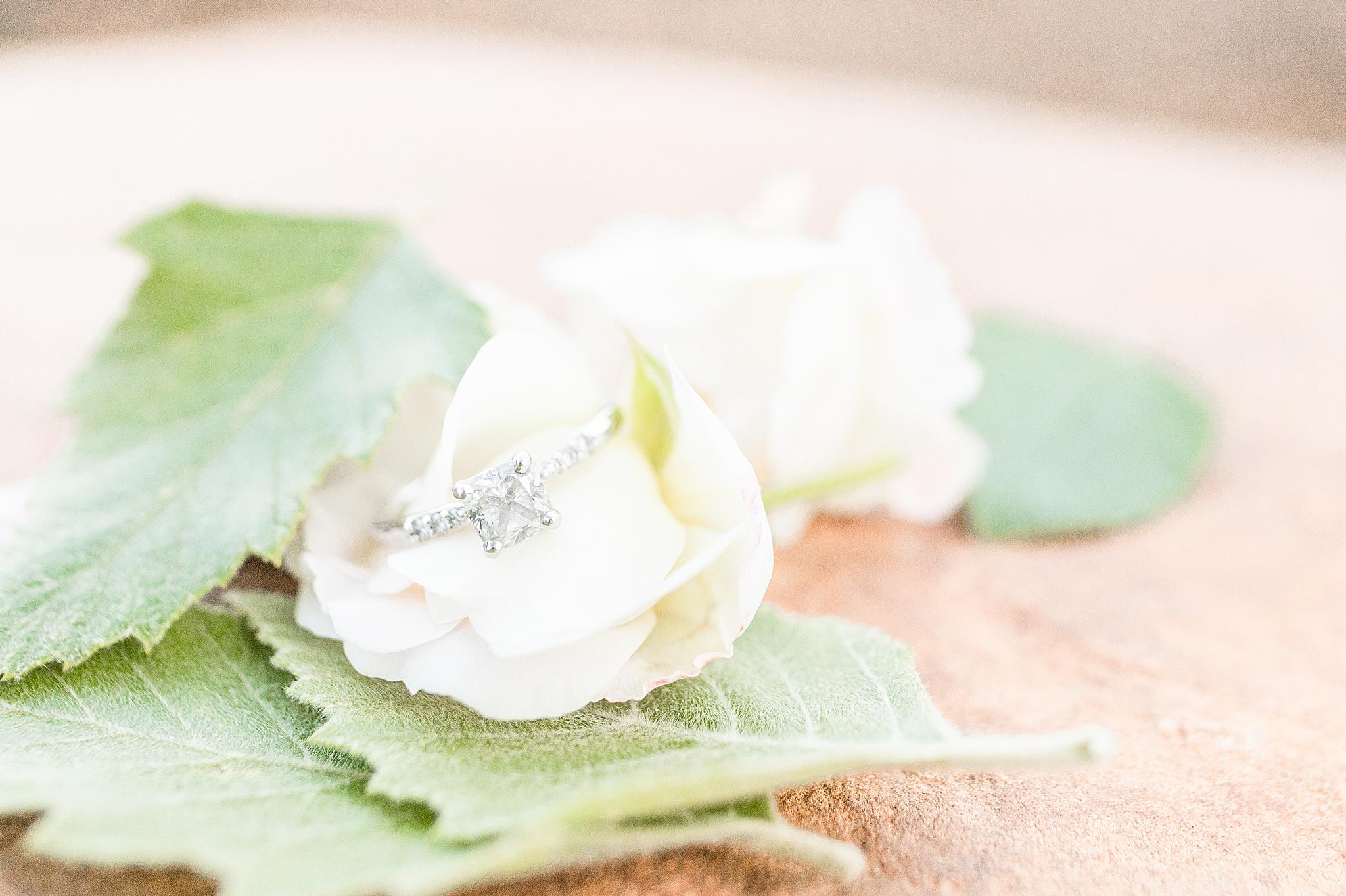 engagement ring on white flower