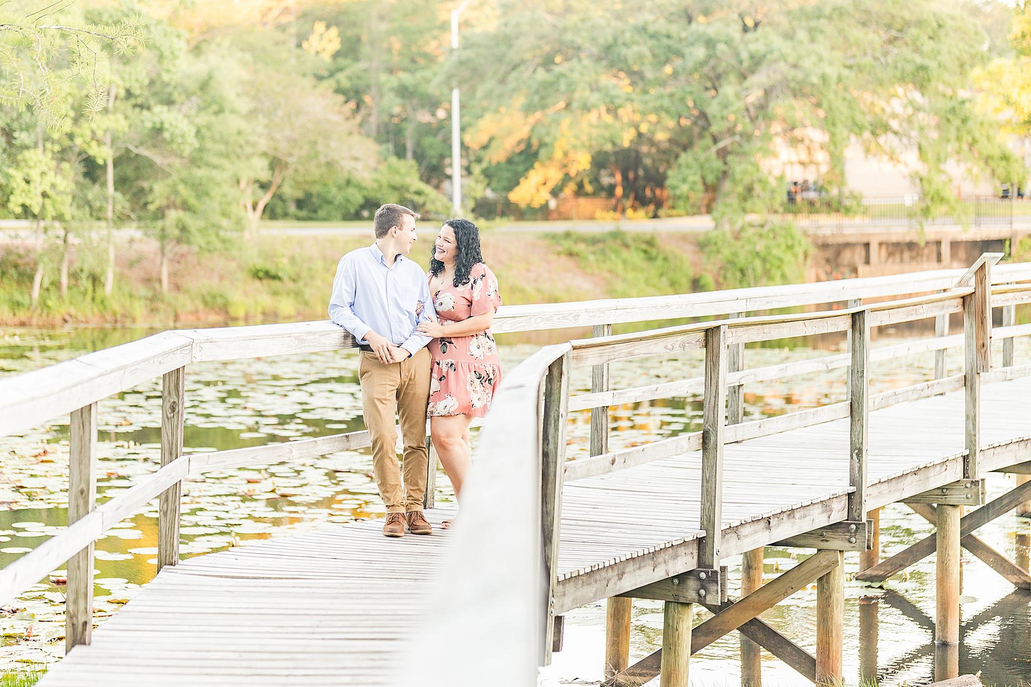 couple walks on bridge in Bienville Square