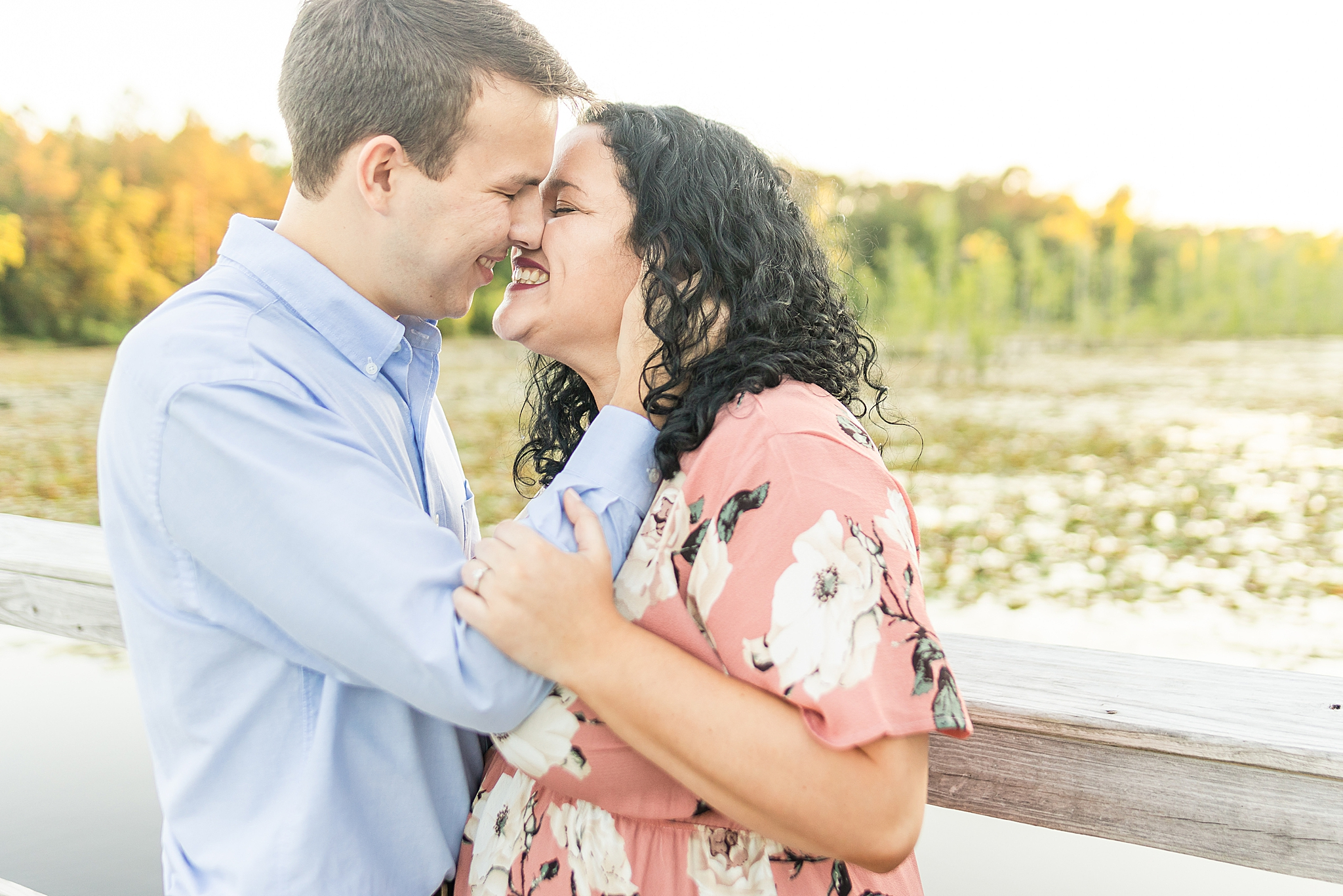 couple laughs standing nose to nose during Alabama engagement photos