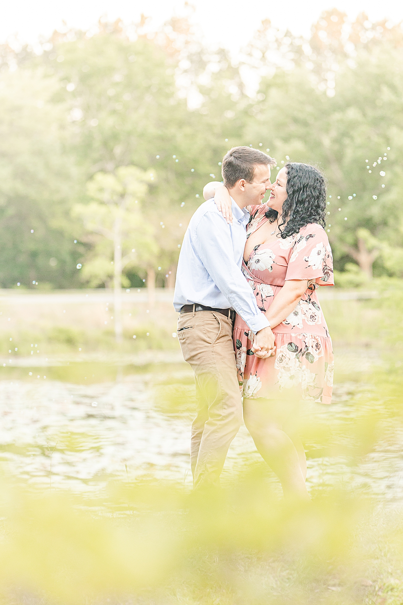 engaged couple dances in park during Alabama engagement session