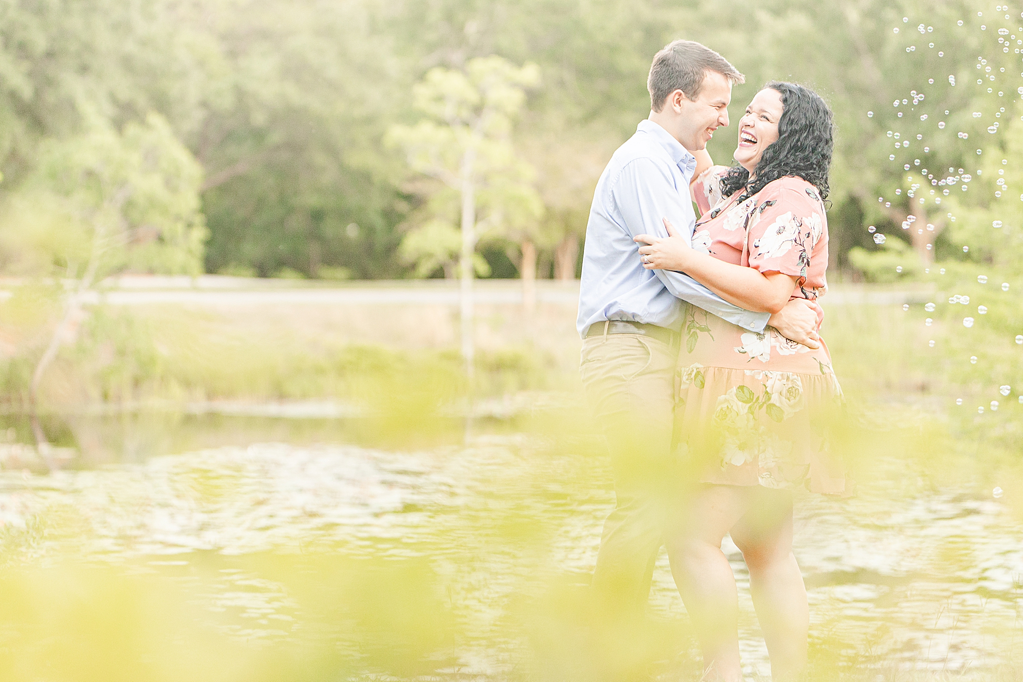 engaged couple laughs during Bienville Square engagement photos