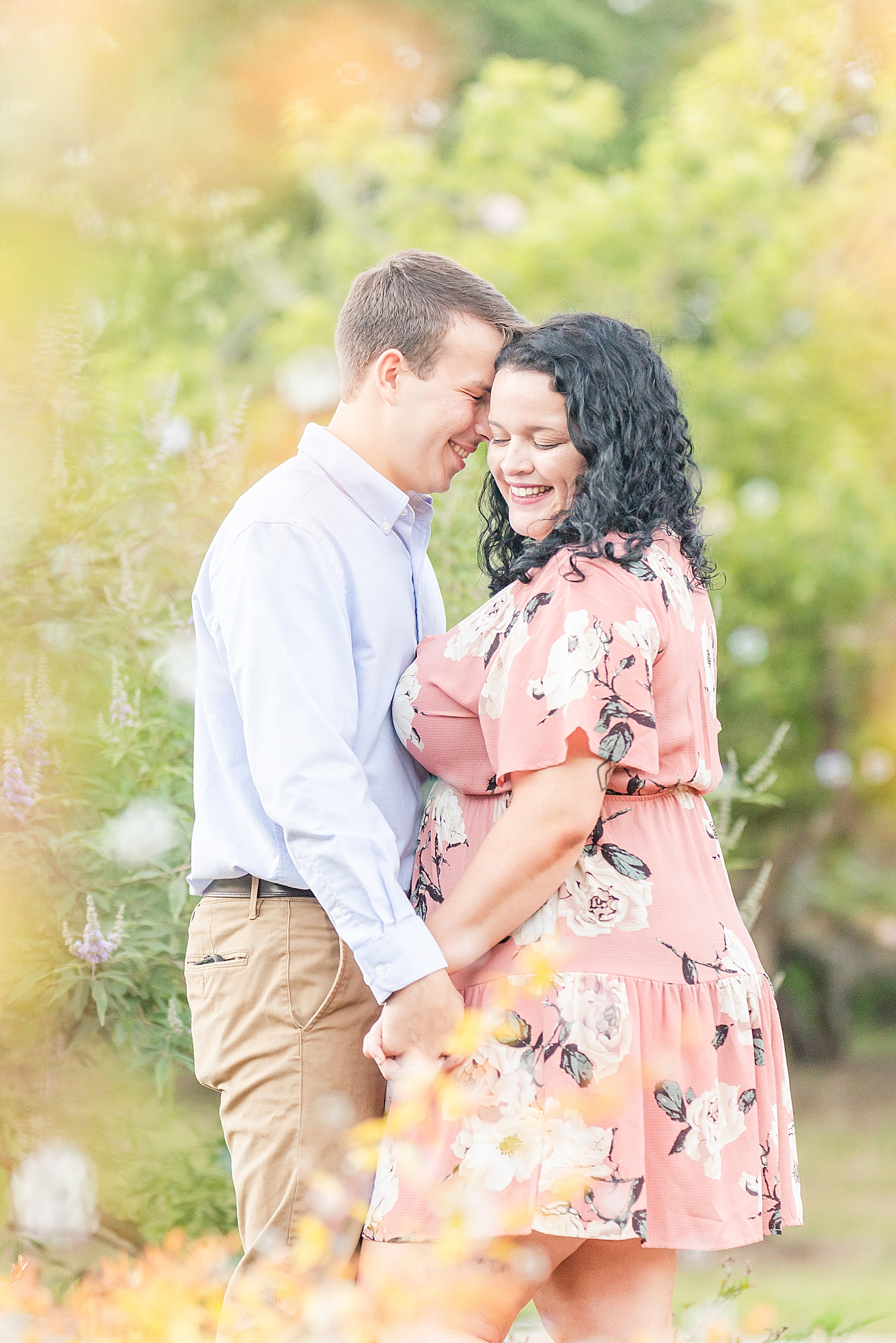 groom nuzzles bride's forehead during Alabama engagement session