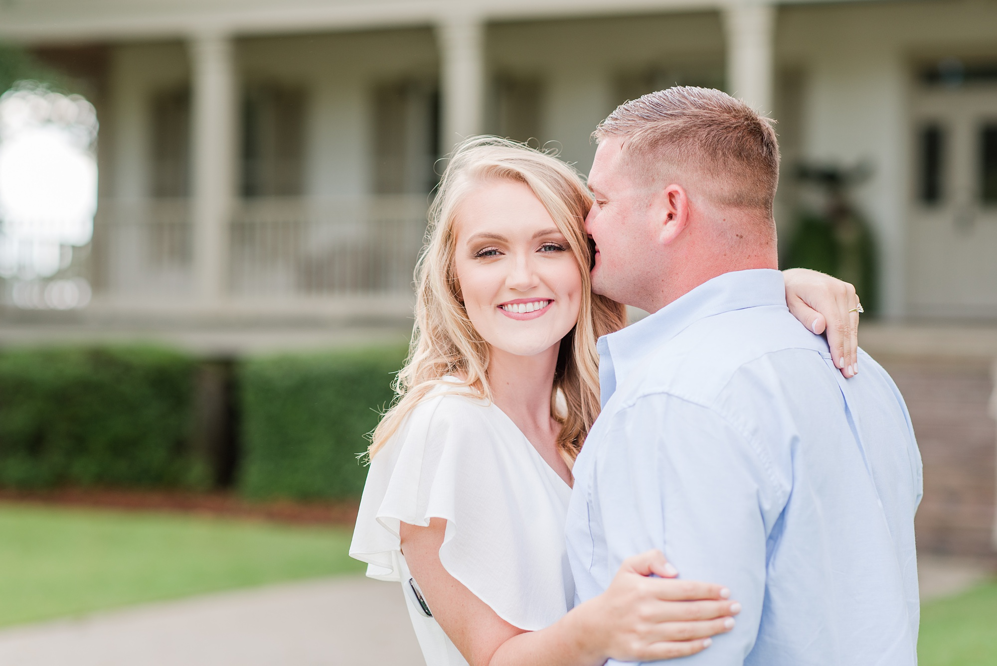 couple hugs during Wharf at Orange Beach Engagement session