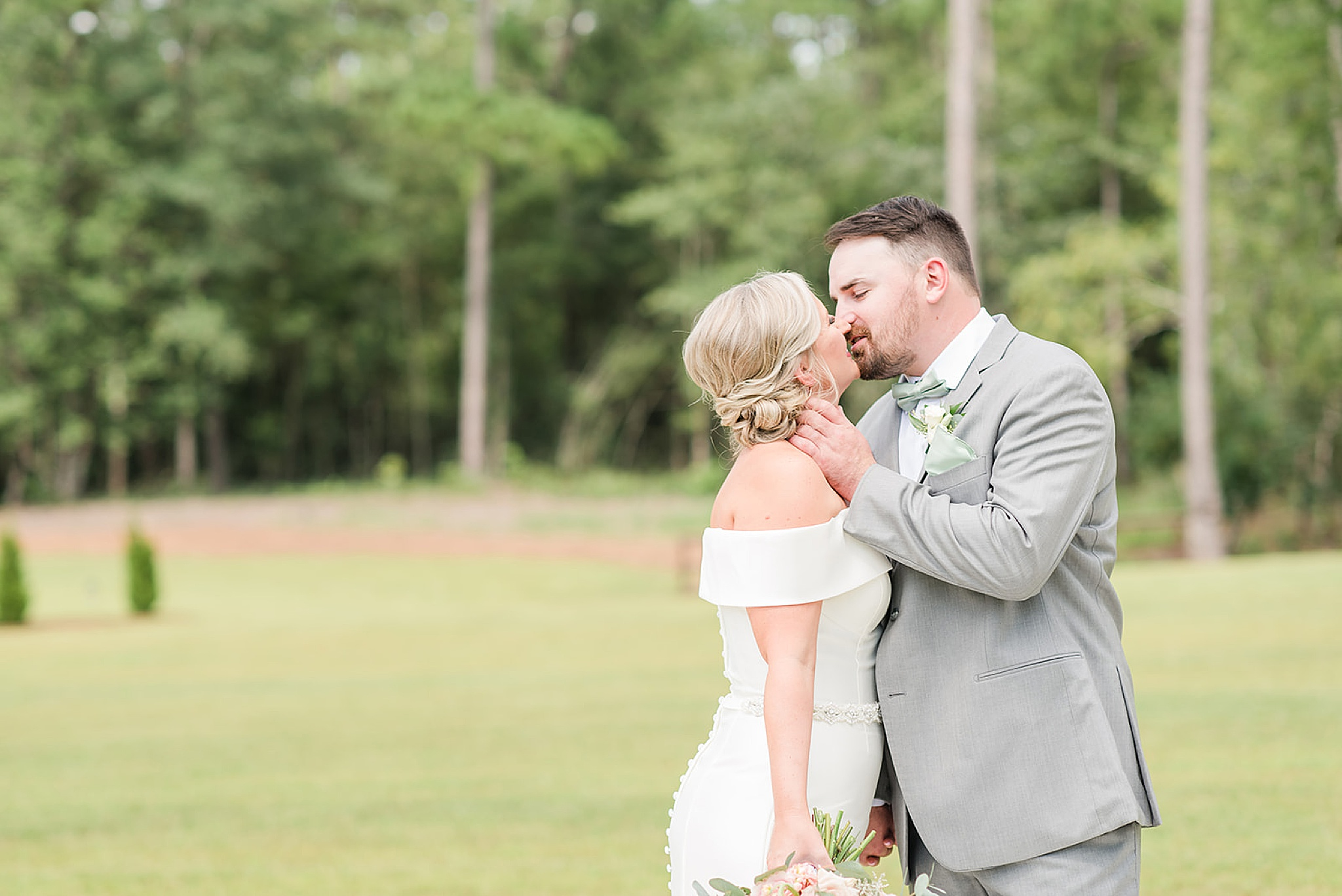 newlyweds kiss before Izenstone summer wedding