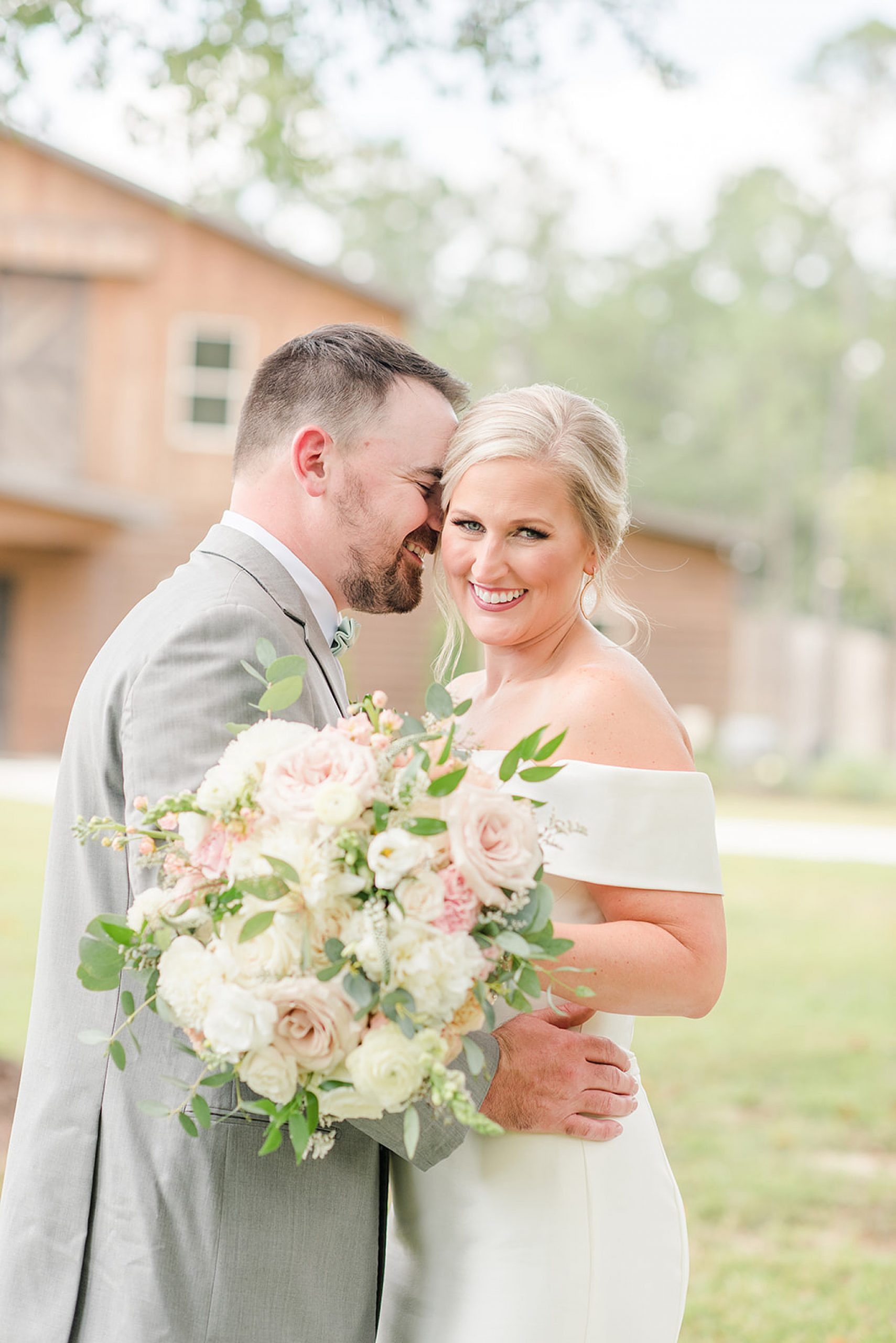 groom nuzzles the bride during portraits at Izenstone