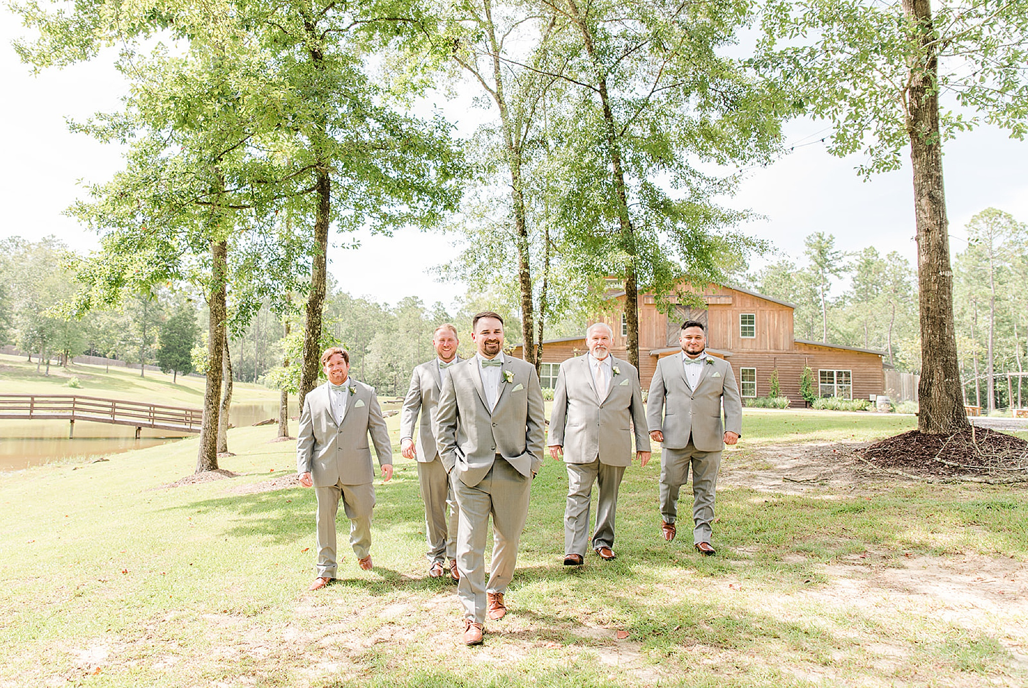 groomsmen walk along Izenstone's property