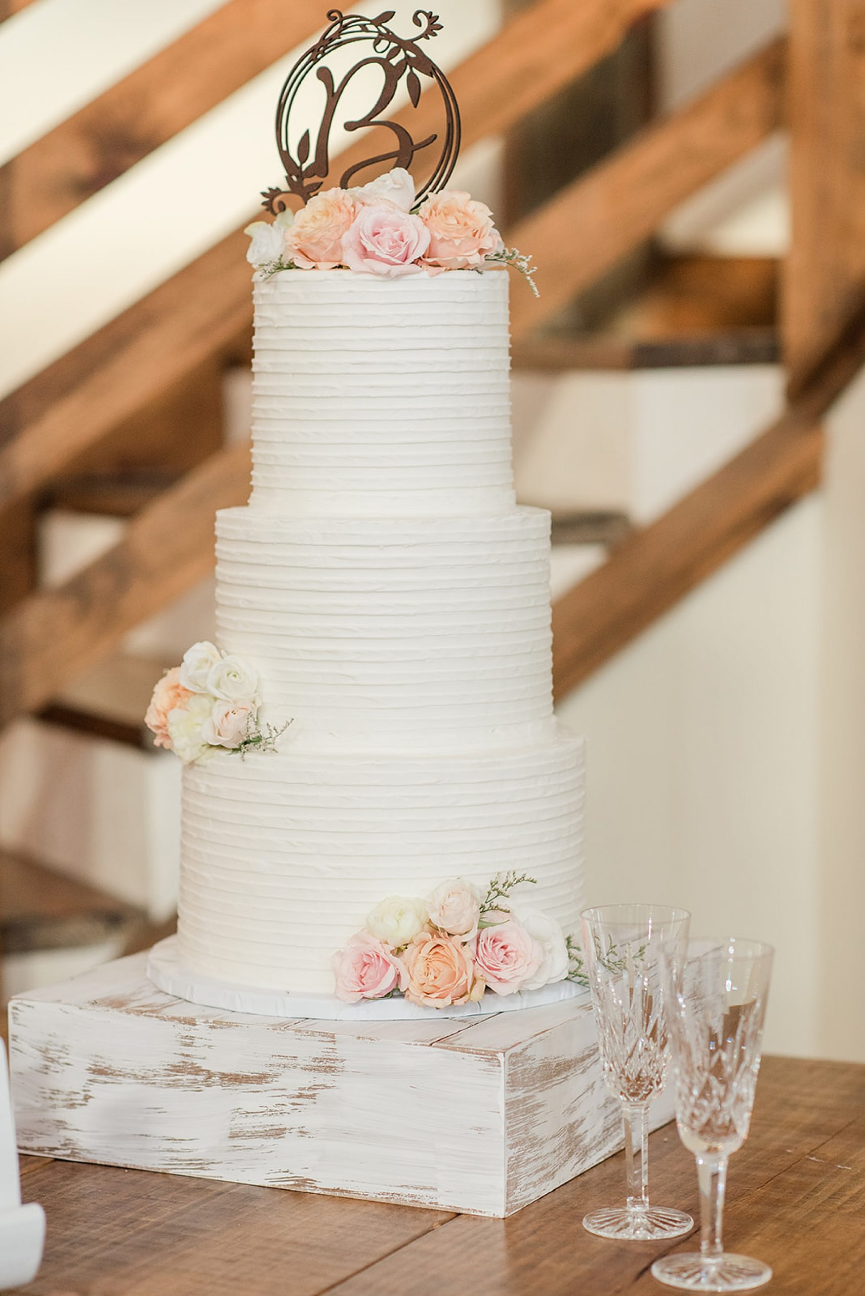 tiered wedding cake with pastel flowers