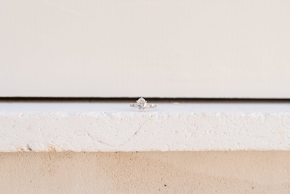 diamond engagement ring on ledge during AL engagement photos