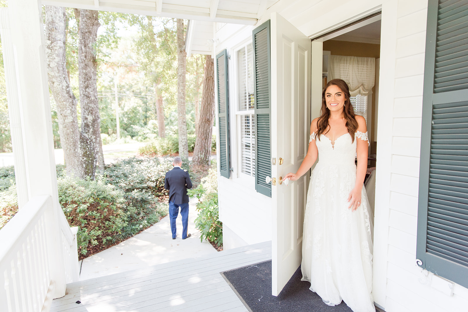 bride walks out to first look with dad