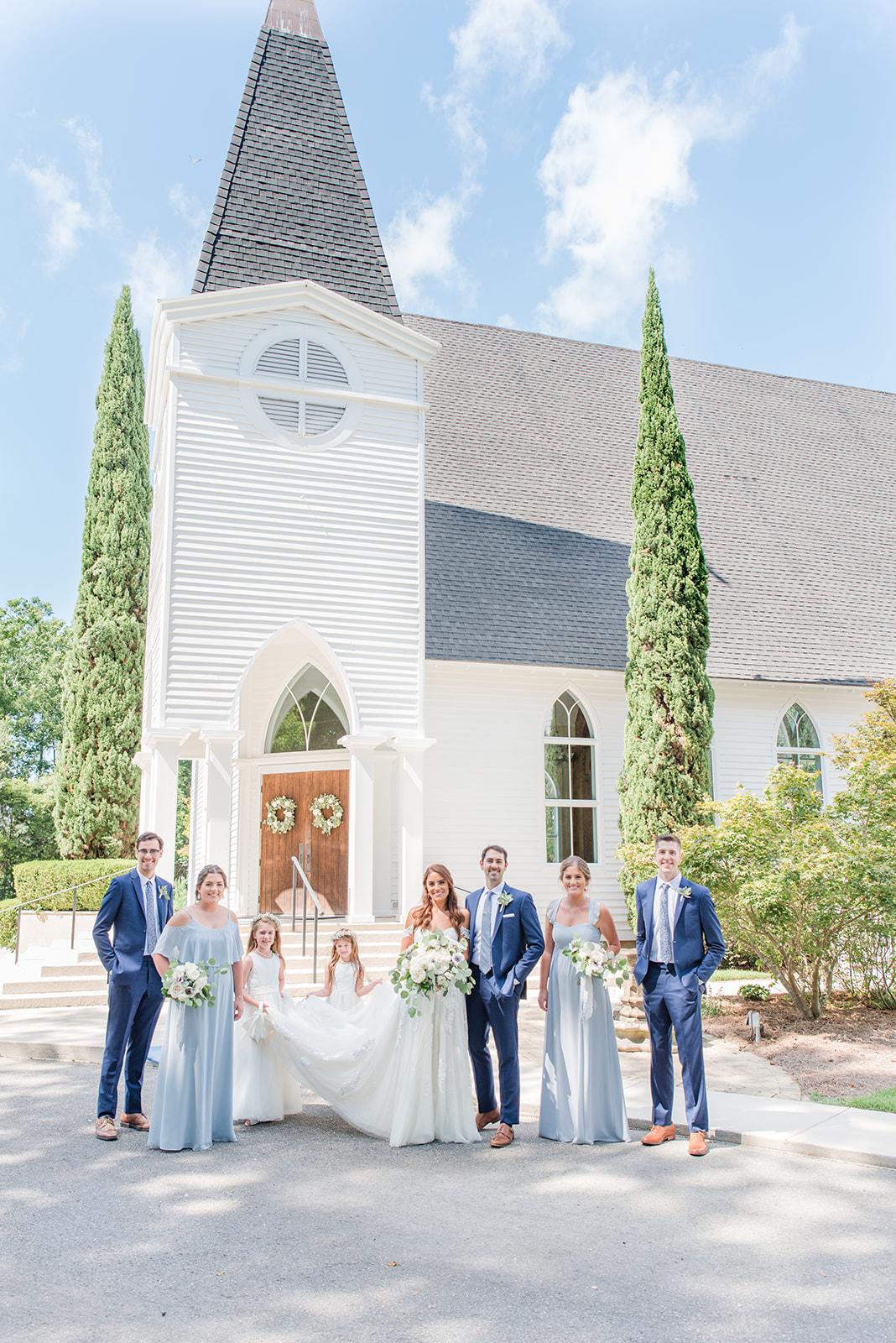 Fairhope AL destination wedding party poses outside church