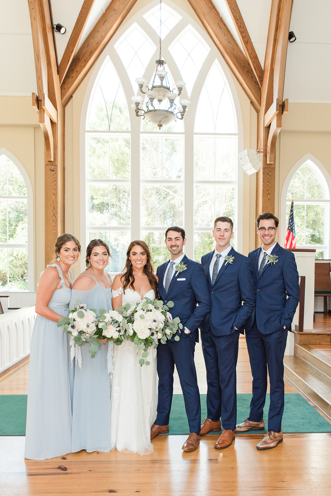 bridal party poses with bride and groom in St. Francis