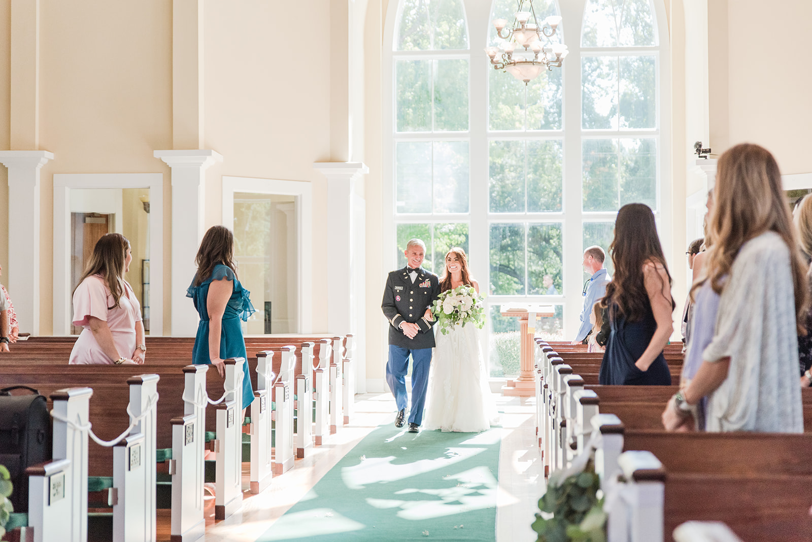 bride walks down aisle with dad in St. Francis
