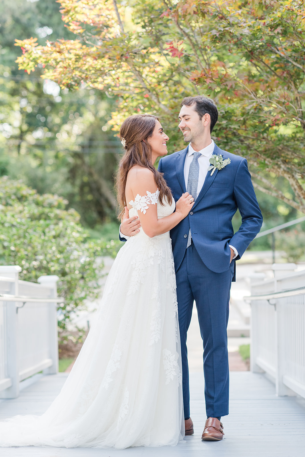 bride and groom pose during Fairhope AL destination wedding portraits