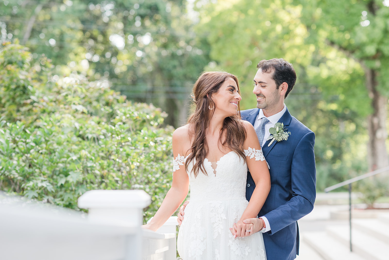 newlyweds look at each other during Fairhope AL destination wedding photos