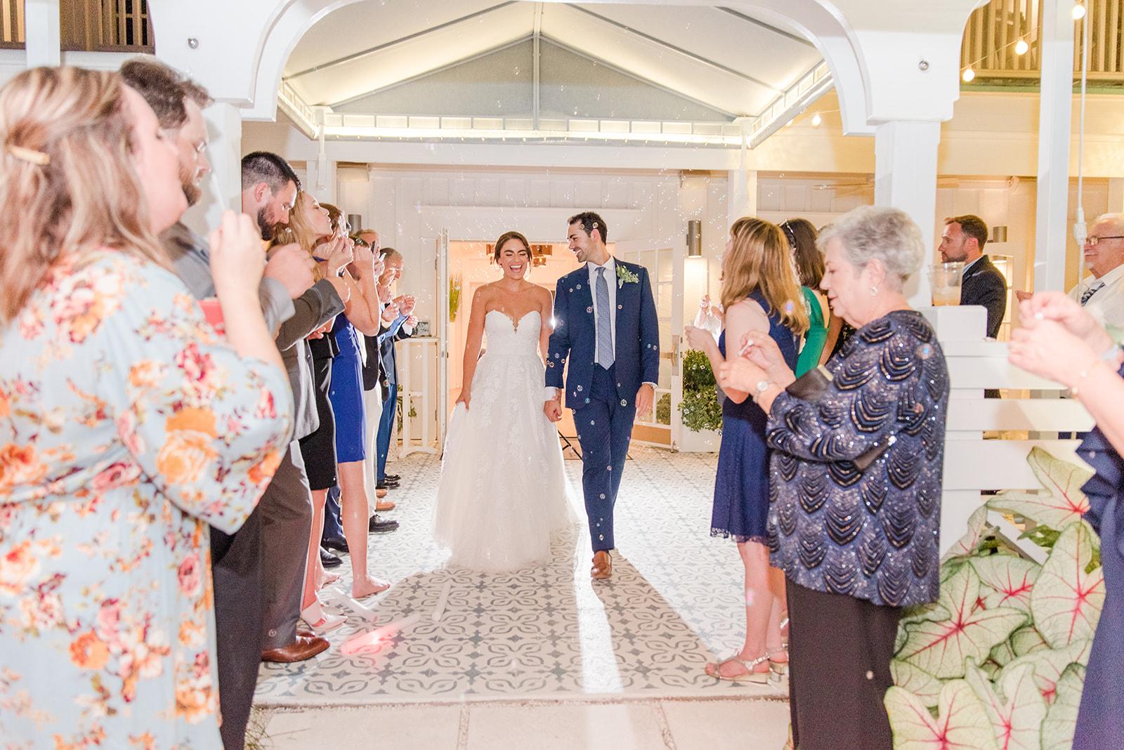 bride and groom leave Fairhope AL destination wedding reception