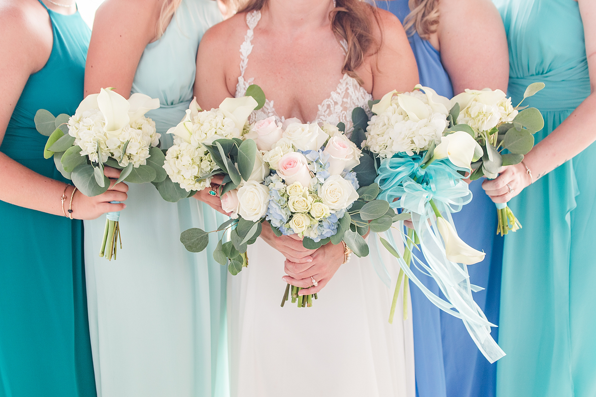 bride and bridesmaids hold bouquets for Gulf Shores Wedding Chapel wedding