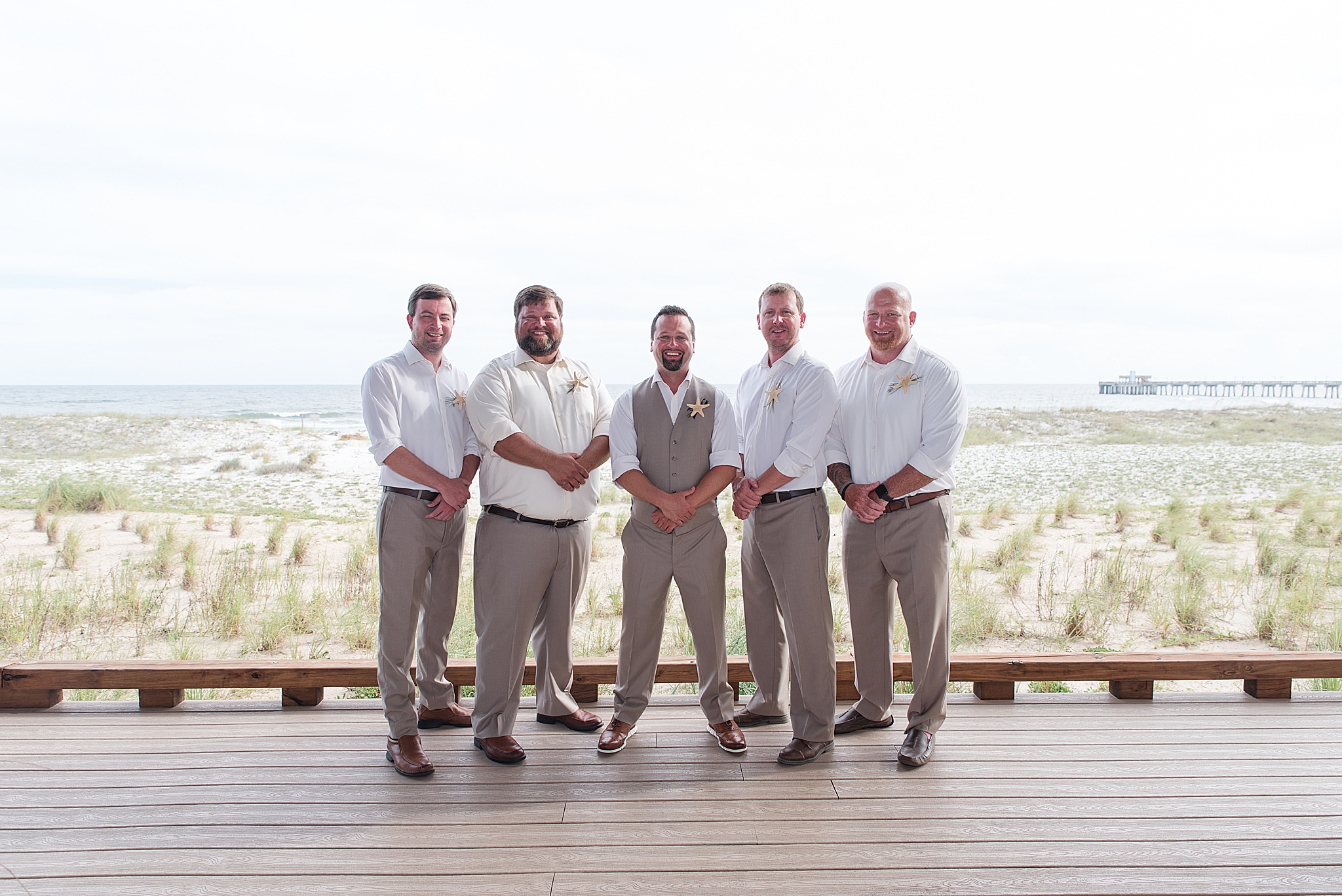 groom poses with groomsmen before Gulf Shores Wedding Chapel wedding