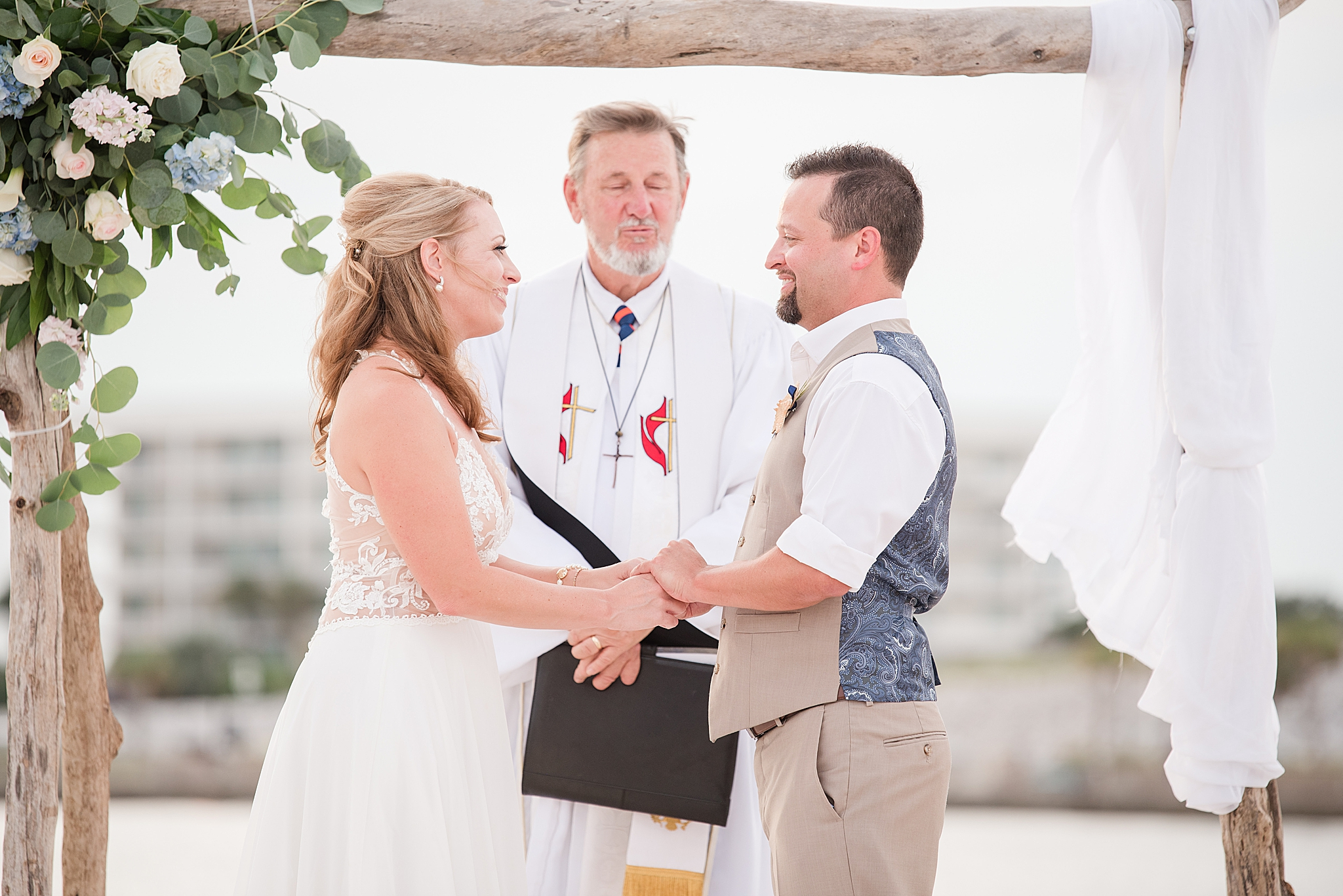 couple exchanges vows during beachfront wedding