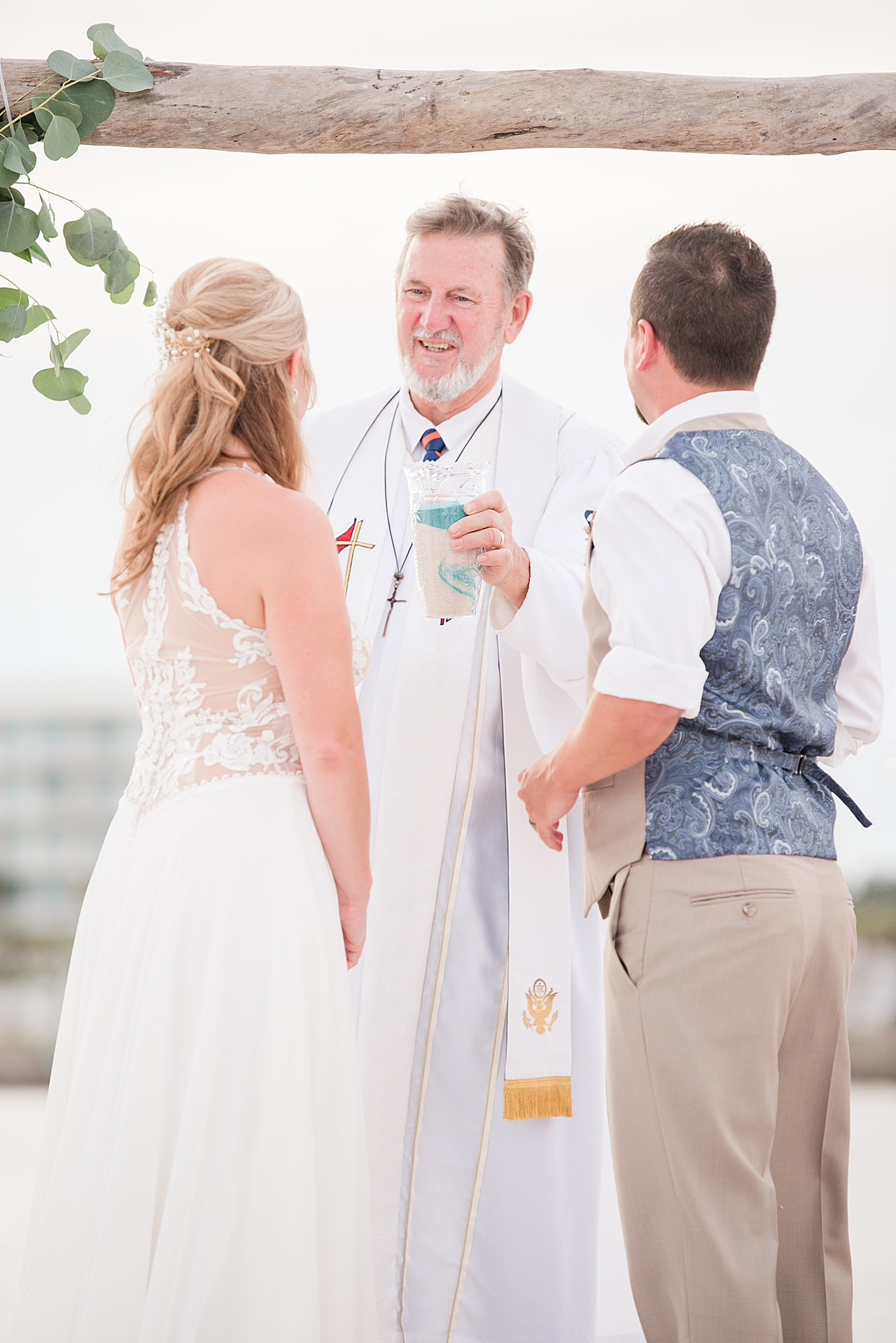 bride and groom exchange vows during Gulf Shores wedding