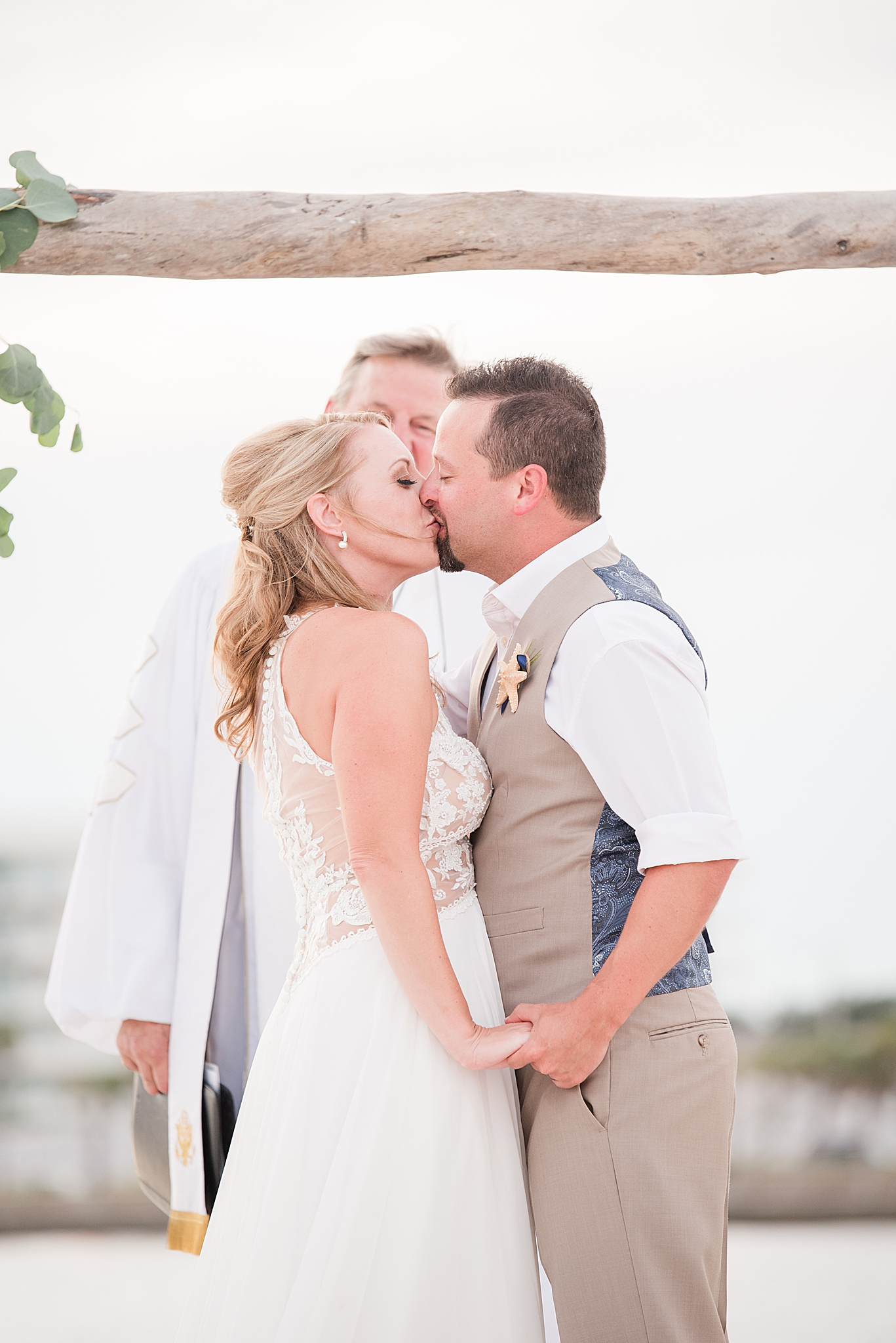 first kiss as husband and wife on beach