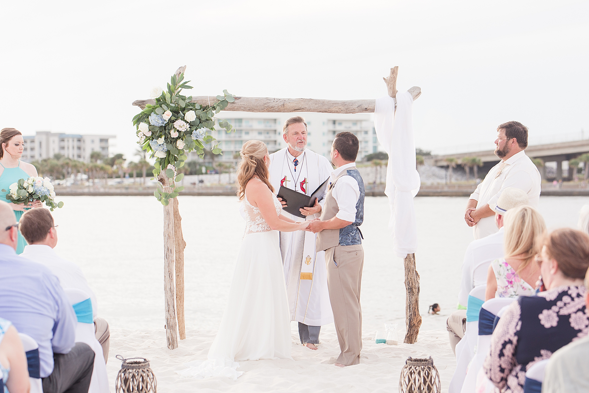 newlyweds share vows during oceanfront wedding